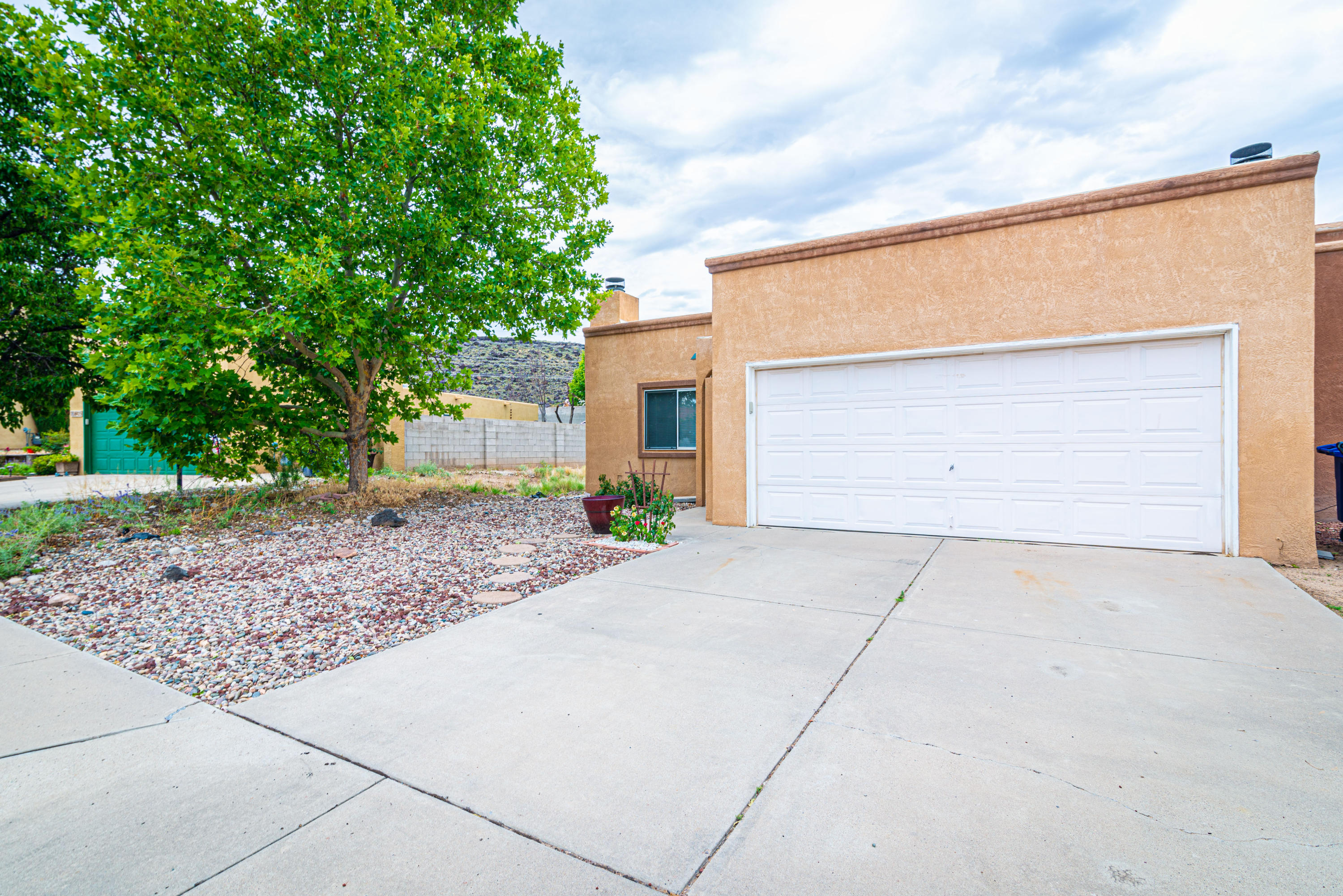 This nicely updated townhome has a warm feeling throughout! Total kitchen re-do in 2011 opens to greatroom and has lovely cabinetry and ample spaces; Spacious greatroom is bright and airy, has a raised ceiling, decorator ledges and a cozy FP; Pretty engineered wood flooring everywhere. New HVAC unit in May, 2020, TPO roof in 2015, new doors, fresh paint. Walk to neighborhood park. Shows Great!