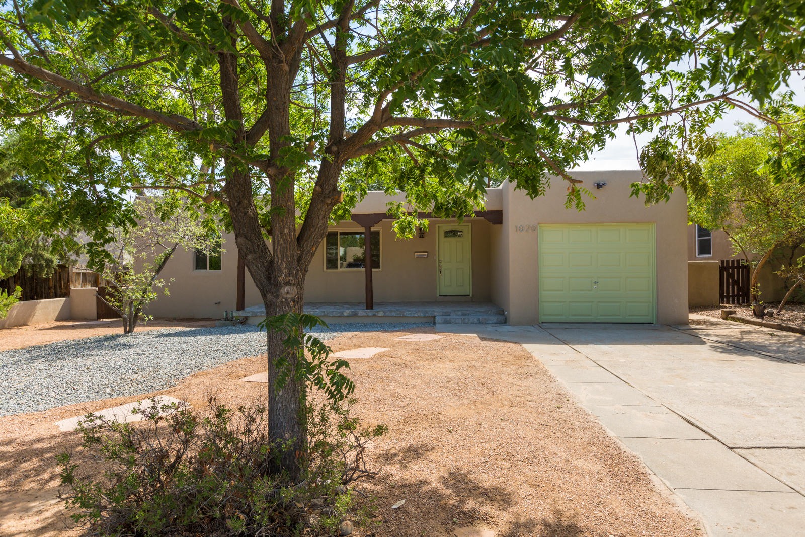 Beautiful fully remodeled home located in the UNM area! Home features 1,220sf with 3 bedrooms, 2 bathrooms and a garage. Upgraded laminate wood flooring throughout the main living areas.  Gorgeous new eat-in kitchen with custom cabinetry, granite countertops, tile subway back splash, stainless steel appliances, kitchen bar with stone accents. Owners suite with private bath! New bath with a custom vanity and a large walk-in shower with a custom tile surround. Great backyard fully fenced for privacy and a large covered patio.  New windows, new cool/combo, paint, hot water heater and more!  Near UNM & Nob Hill!