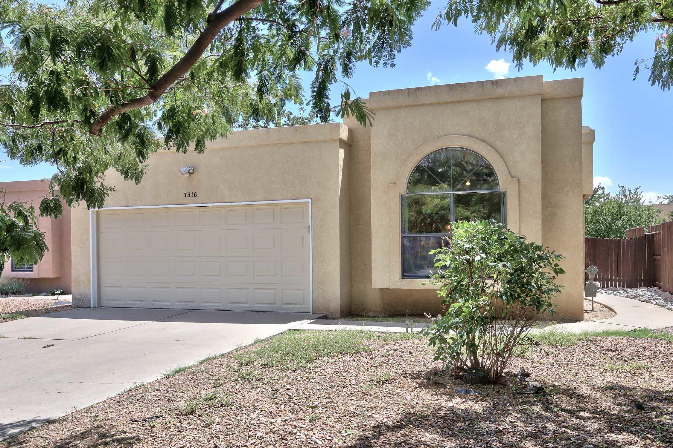 Charming 3-bedroom starter home on a quiet street in Ladera Heights, ideally located with easy access to I-40, shopping and restaurants, and even a dog park! Light-filled kitchen with ample eat-in dining area features gas stove and sliding glass doors to outside private yard, perfect for entertaining. Large master bedroom has full attached bath. Living areas are light-filled and cheery.  Lovely backyard features trees, rose bushes and large storage shed. 2-car drive-through garage is ideal for car lovers and mechanics. Great location and setting at an affordable price!