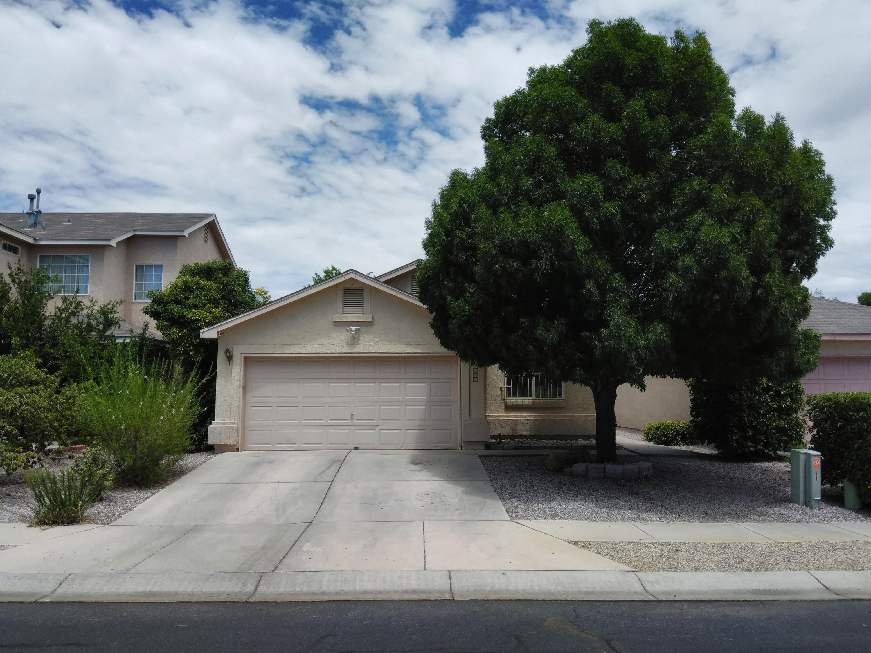 This home has incredible features! Custom entertainment in the living room selling with sound system! Raised ceilings and wrought iron security bars over windows and backdoor. Cement, Grass, Sprinklers, Shed, Tree, and Sun Sail Shade are great additions to the backyard! Beautiful large tile, wood floors, updated fixtures, water heater replaced in 2019, master cooler keeps summer cool! Great features ready to enjoy along with being a part of a gated community with security!