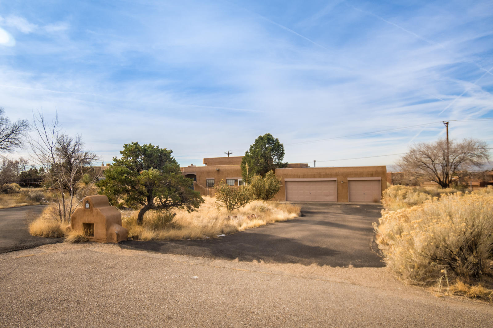 Fantastic views of Albuquerque from the home that sits on the center of a Cul de Sac drive. Front driveway is asphalt and is a circle driveway. Newly painted interior with new carpet and tile inside the home. Separated Master suite from other bedrooms. Front courtyard. Back covered patio area.