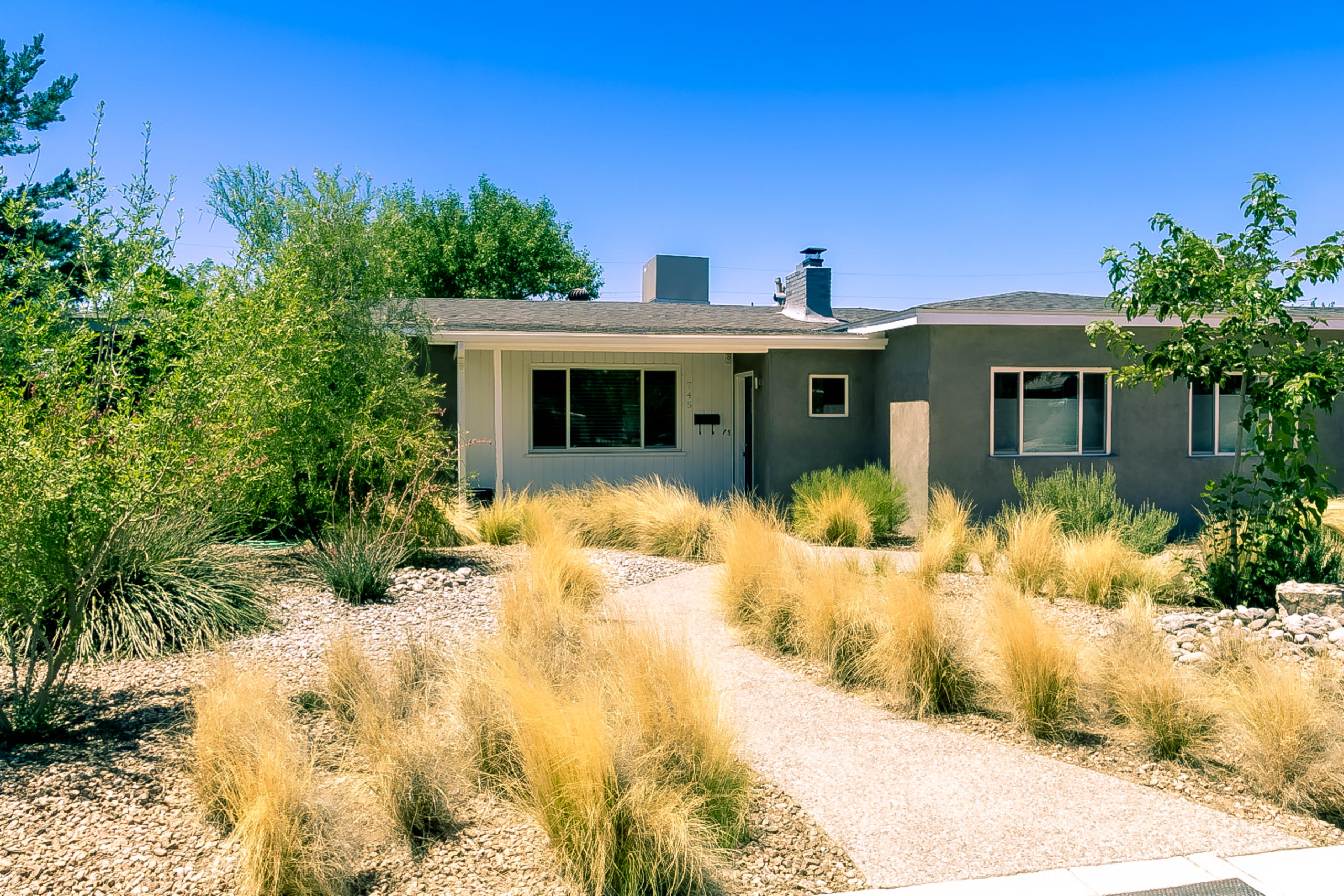 It's 745 Morningside Dr NE- classic mid-century ranch turned contemporary chic w/ architect-designed renovation. In the heart of the La Hacienda neighborhood, the sunlit home is just 2 blocks from Twin Parks & McDuffie Park. Exceedingly livable, 2,280 sq ft, 4 bd, 1.75 ba, thoughtfully designed & impeccably updated. Open kitchen w/ quartz counters & adjoining laundry room. Oversized 1.5 car pull-through garage w/ doors at front & back. Oak hardwood floors. Hallway bath fully remodeled 2020. Recent renovation includes pitched shingle roof, master bed/bath re-do, stucco, HVAC, tankless H2O heater, can lighting, thermal windows, den addition w/ sleek concrete floor. Huge lot, xeriscaped front & verdant backyard w/ 2 separate patios & sprinkler system. Close to Nob Hill, UNM, dining & shopping