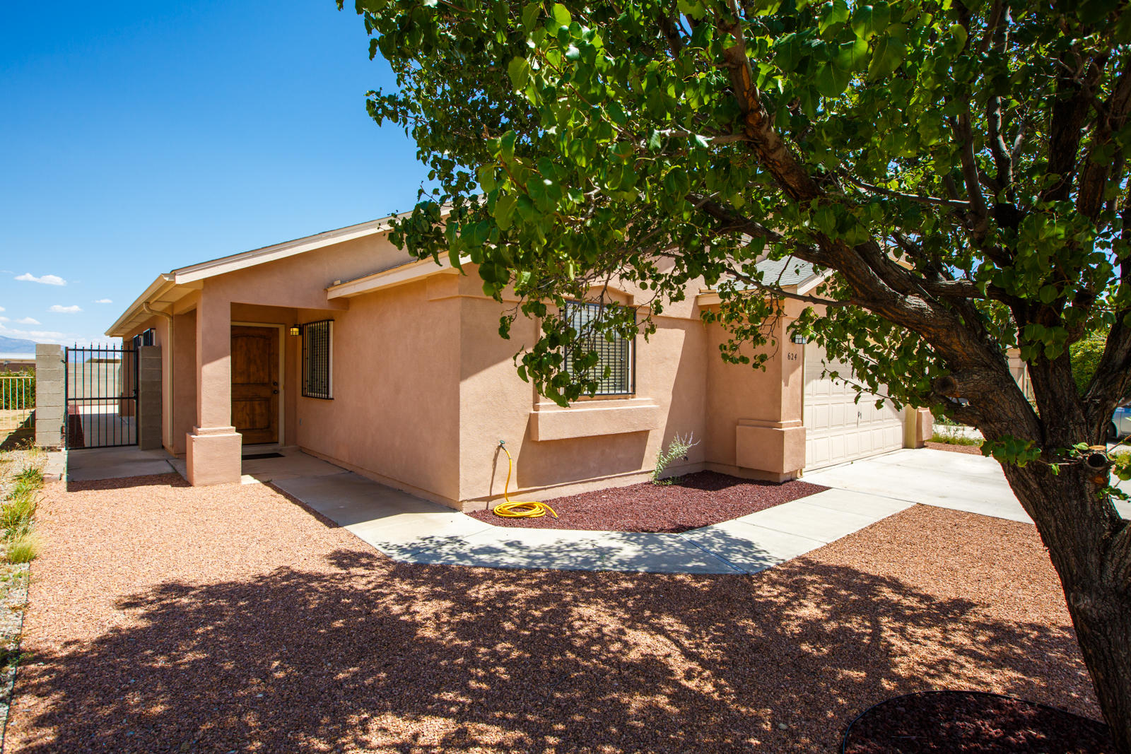 Move in Ready! Pride of ownership is evident from the moment you enter. New front door, new flooring, paint, and baseboards in living room area and 2 of the bedrooms  Backyard features covered patio. Front yard has been landscaped and is low maintenance!