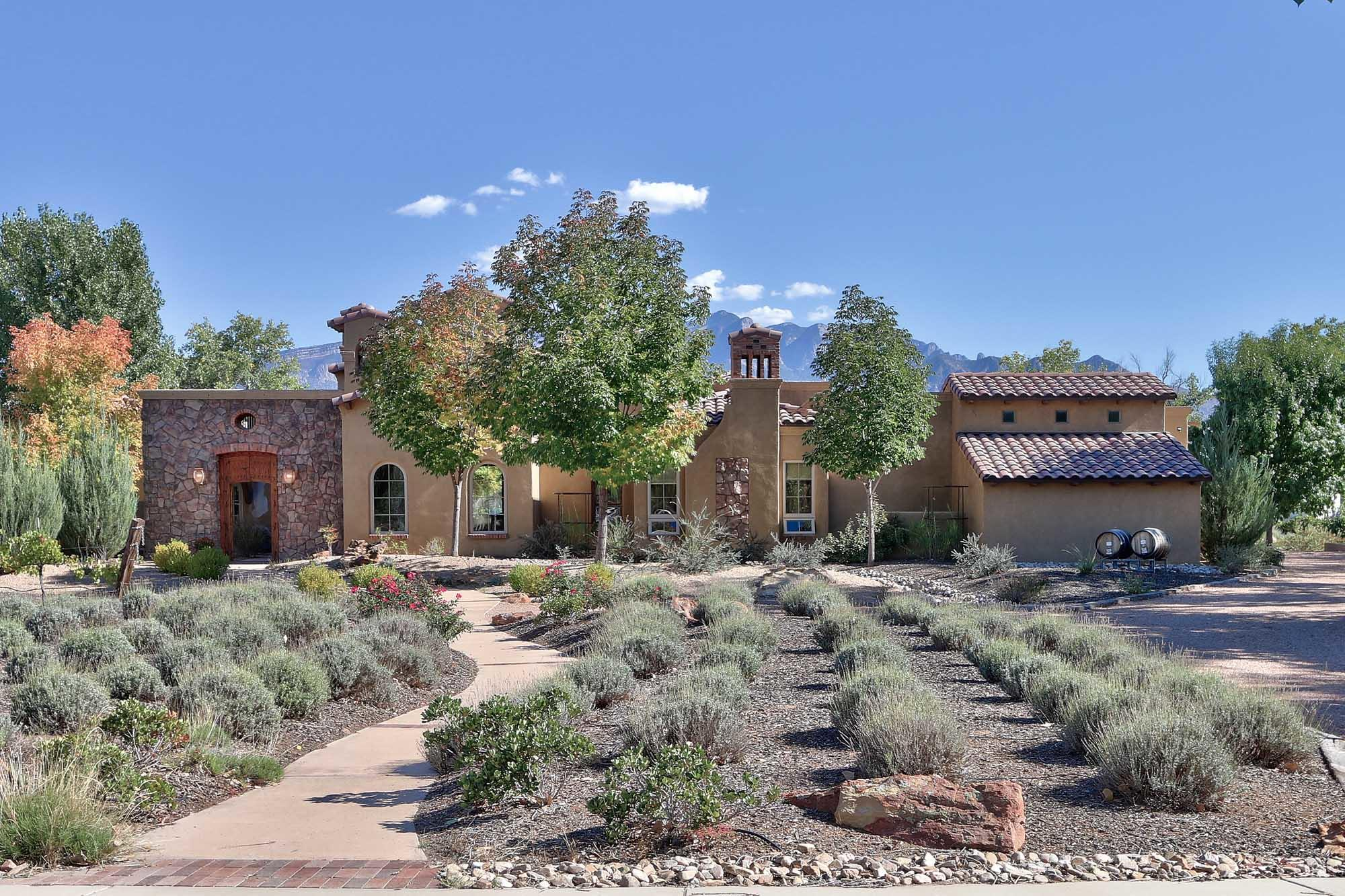 Exquisite home in in the Rio Grande Bosque. Set in it's own private vineyard designed to grow and produce your own wine. Hard to find 2.74 acre lot. Extraordinary Tuscan design loaded with  luxury features. Gorgeous gourmet kitchen features a lovely morning room. Picturesque views of the mountains and Bosque enhance most rooms and outdoor spaces.  Great Room features open truss ceilings and Cantera marble fireplace. Private, separate guest wing. Master suite features intimate patio and age in place elegant bath.  Incredible second story view deck for amazing sunset and mountain views.Located in a gated compound of high-end homes.  Convenient commute to both Santa Fe and Albuquerque.