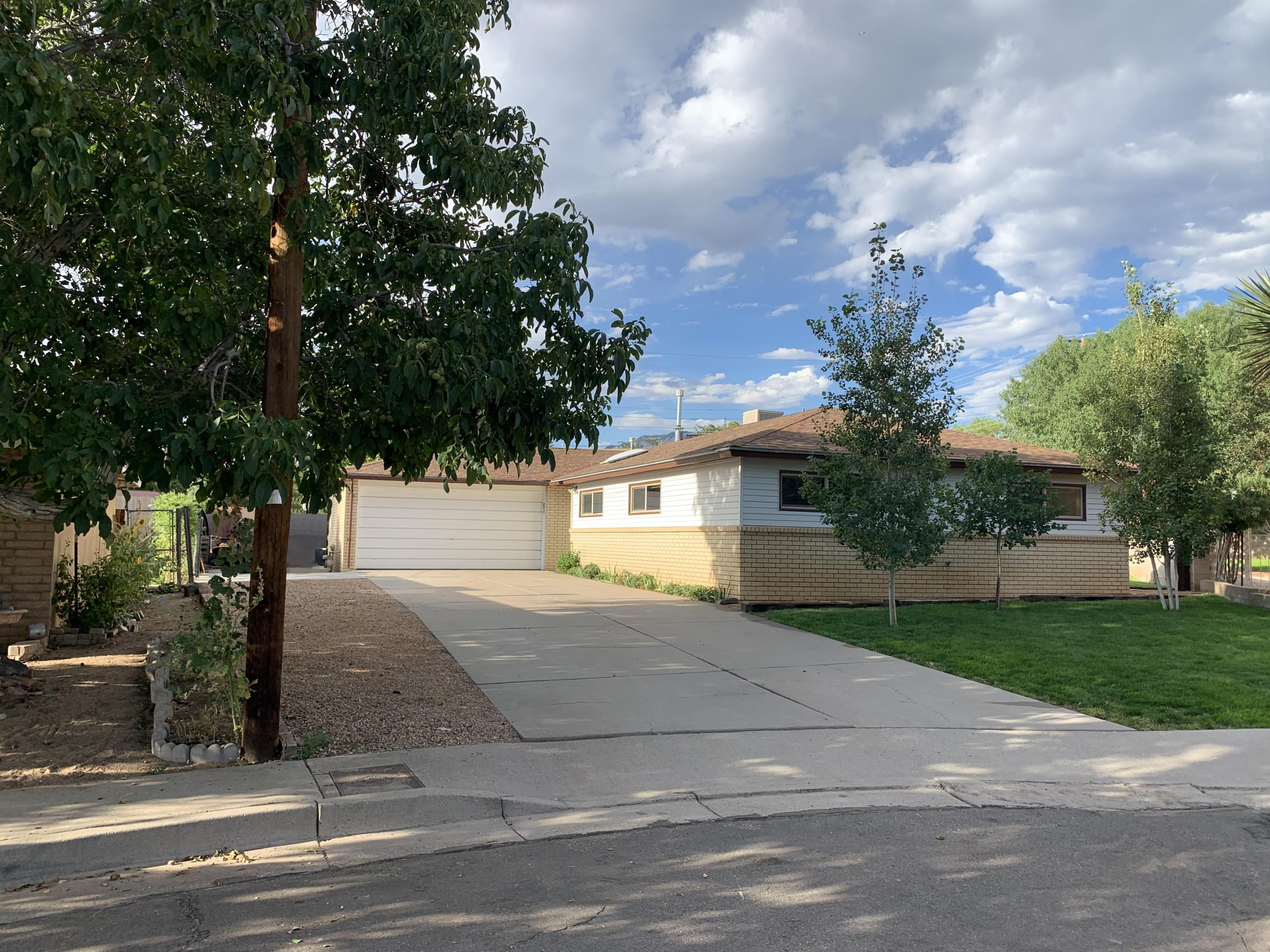 Four bedrooms on a cul-de-sac with fantastic location. Remolded and renovated, immaculate and well maintained, this home is BEAUTIFUL!Newer kitchen, windows & roof. Brick veneer. Views of Sandias. Covered outside porch.The gardens are a pride and joy with a wonderful vegetable patch and much more!