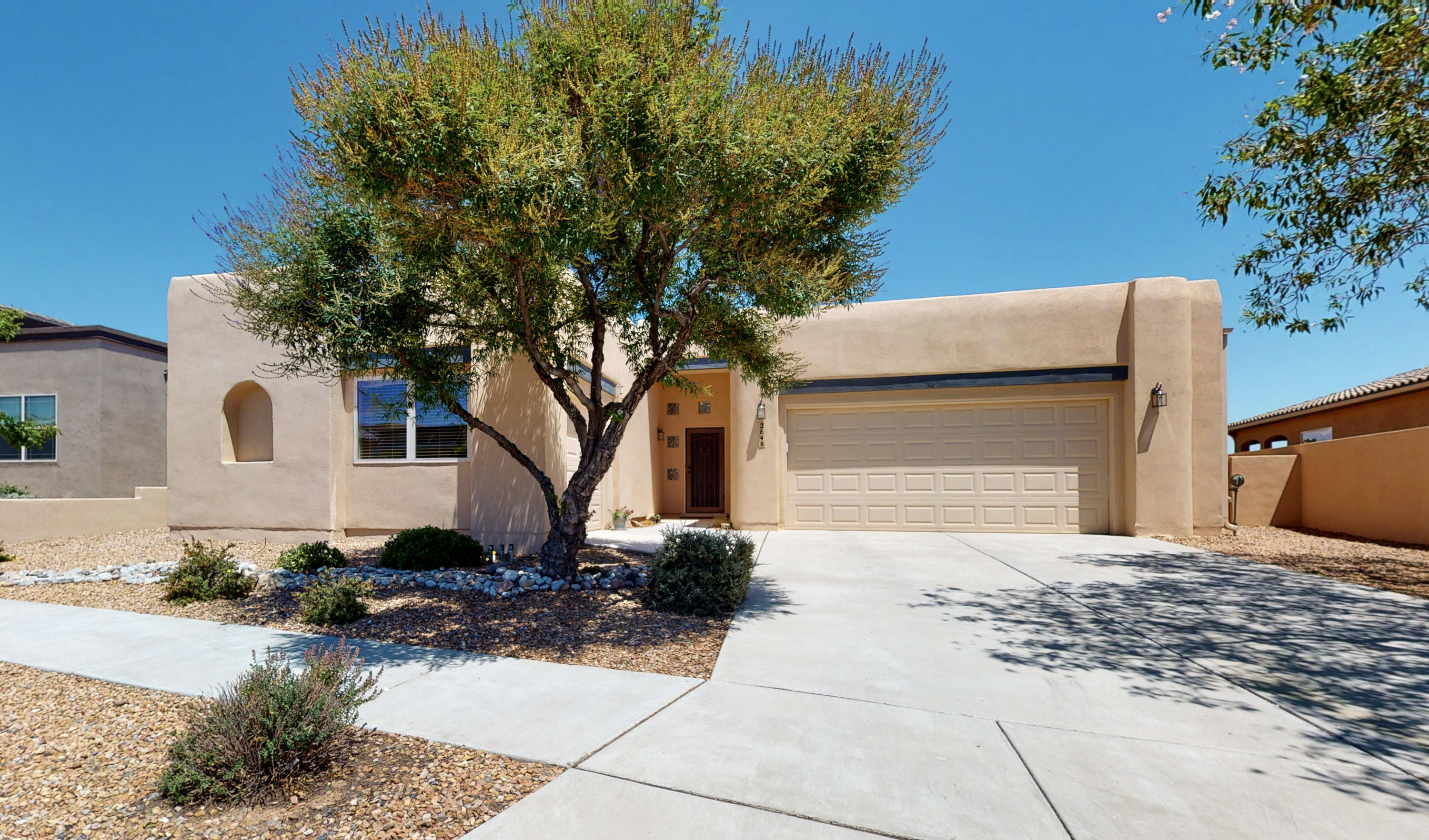Single level living at its best.  You enter into a wide welcoming foyer.  A gorgeous huge living/dining room combo is perfect for entertaining; corner fireplace and lots of light.  Beautiful granite in the large kitchen - big island plus a breakfast bar.   The master bedroom and other bedrooms are separated for privacy. Master has sliding glass doors to backyard, gorgeous master bath and a huge master closet.   All the rooms are large and the skylights and abundant windows make this a very bright and airy floor plan.  Huge laundry room.  Plenty of storage.  There is a 2 car garage PLUS a one car finished garage that is set up as a workshop.  The backyard is the perfect place to hangout for a cookout.  Two ac/heat combo units.
