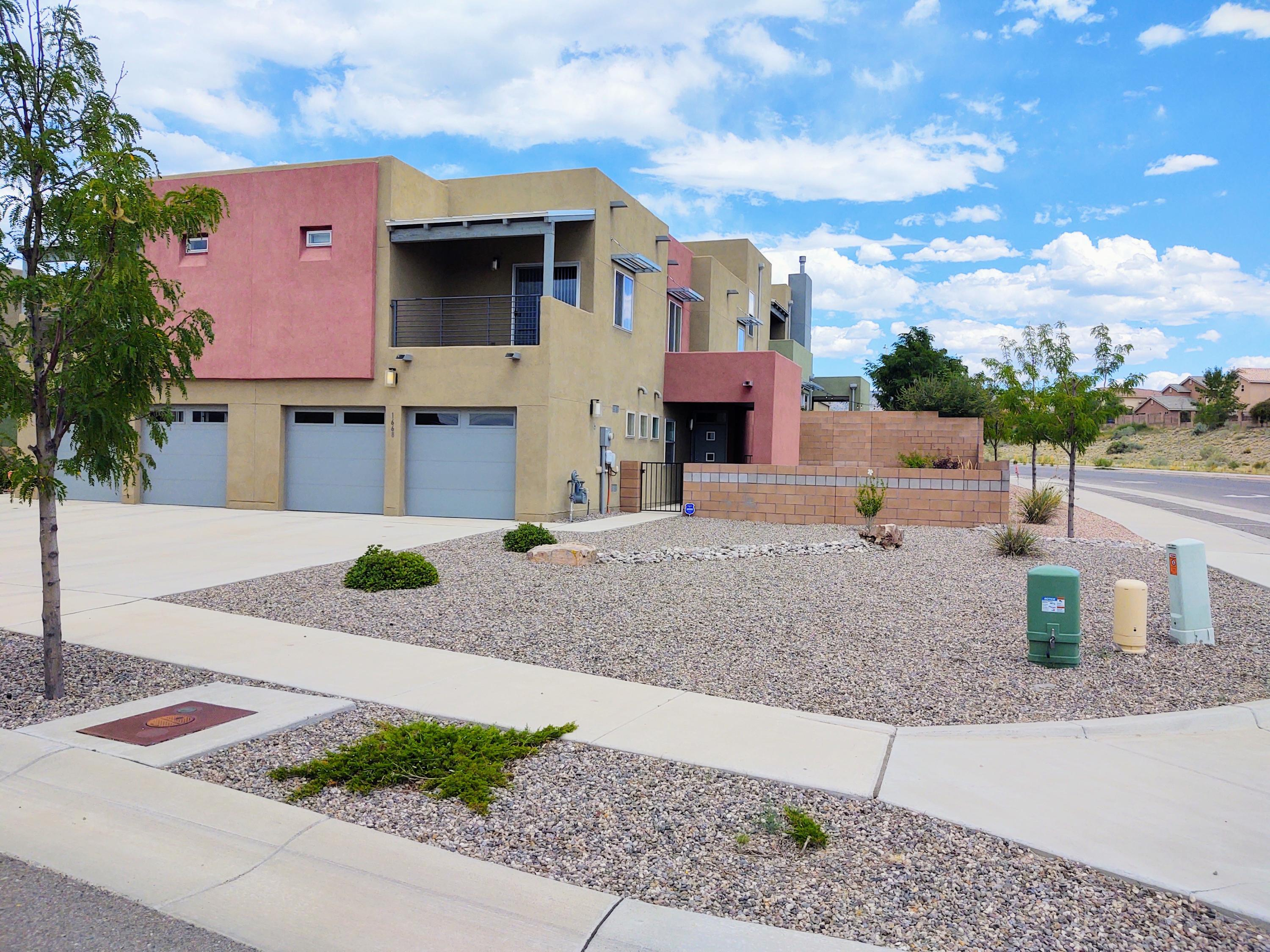 Wow! Look at this wonderful contemporary LGI town home on a over sized corner lot in the amazing Volterra Village subdivision. This great home has a wonderful light, bright and open floor plan, tile flooring throughout the 1st floor, granite counter tops, beautiful cabinets, tile back splash, stainless steel appliances, upgraded lighting, custom paint, huge farm sink and so much more. Enjoy this well put together master bedroom and bathroom with plank flooring, balcony, countertops, double sinks and large linen closet. Yard was professionally landscaped and has a fire pit plus sitting area. This is a must see to believe home and priced to sell.