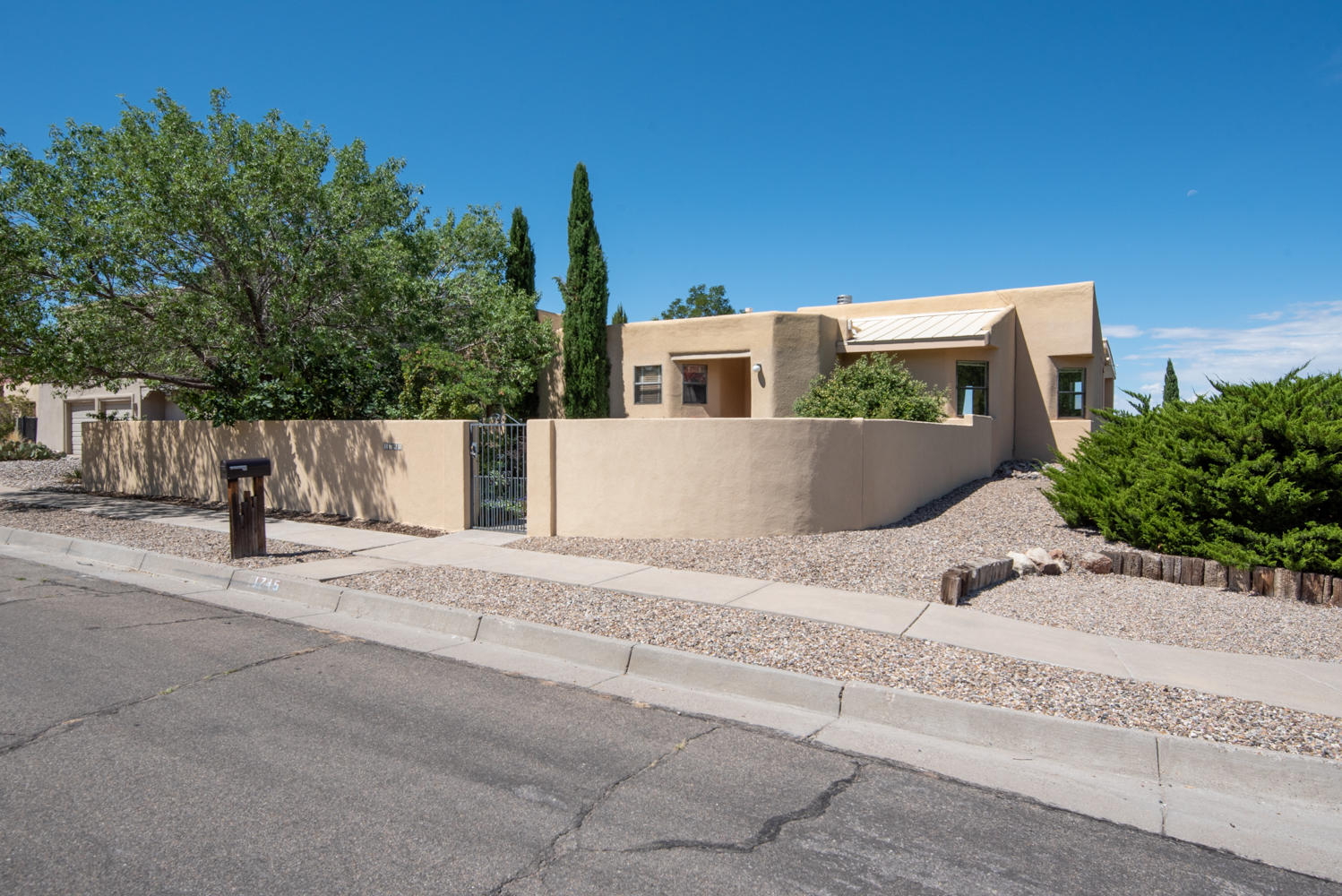 Stunning City and Mountain Views from this fantastic corner lot. Mature trees and landscaping, flagstone pathway and gated courtyard. Light, bright and open concept floor plan with a huge covered balcony off the family room boasting amazing views! 3 bedrooms with the master on the main level. Kitchen features electric cooktop built in , some stainless steel appliances, (all convey)  island and updated cabinetry. Tons of natural light from skylights. Owner suite features private balcony access, fireplace, double sinks, and walk-in closet. 2 car garage, wet bar, refrigerated air and so much more you have to see. Some furniture available to purchase (master bed frame, dining room table, rug)