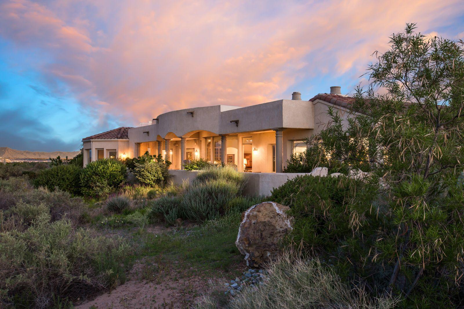 Lovely mission-style home on fabulous view lot in gated Oxbow Bluff.Close to bike and running trails and shopping, the home is designed to showcase the amazing mountain, city and river views. Exquisite details-oversize travertine, tall beamed ceilings and walls of windows, barrel ceiling,stone fireplace, custom doors, crown molding, & gallery hallways to display your art are evidence of quality construction. Chef's kitchen with cherry cabinetry, huge center island w beverage center+steam oven, separate Subzero fridge & freezer,Viking commercial range- opens to family room and dining and both dining areas. Luxurious owner's suite opens to the view patio or a cozy study with fireplace adjacent to the bedroom. Recent roof updates and top of the world roof deck for magical sunsets and sunrises