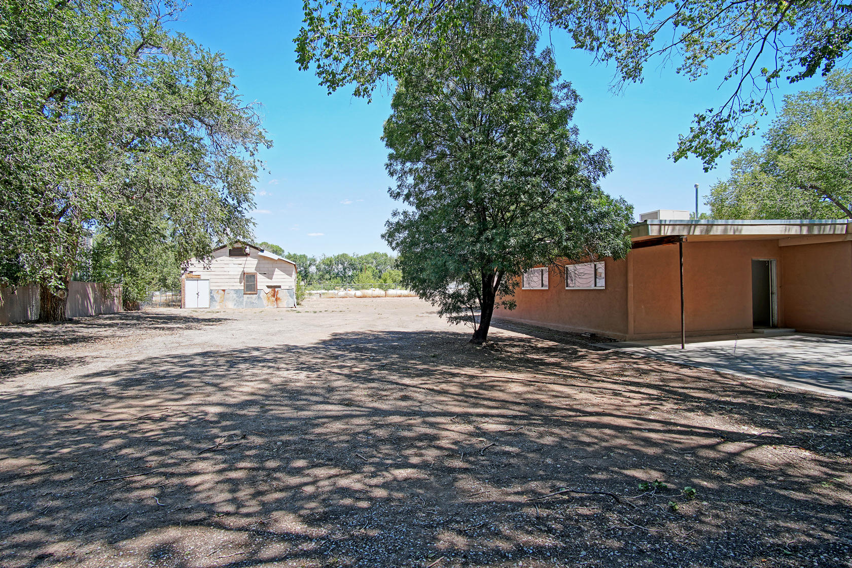 Opportunity! Opportunity! The owners are not able to finish this 3bed/2 bath home. Home is ready for all your personal touches. This .78 ac backs up the ditch with the possible water/irrigation rights. Large barrickes type building, could be a large workshop, garage or casita. Bring your hammer and talent to make this home your.