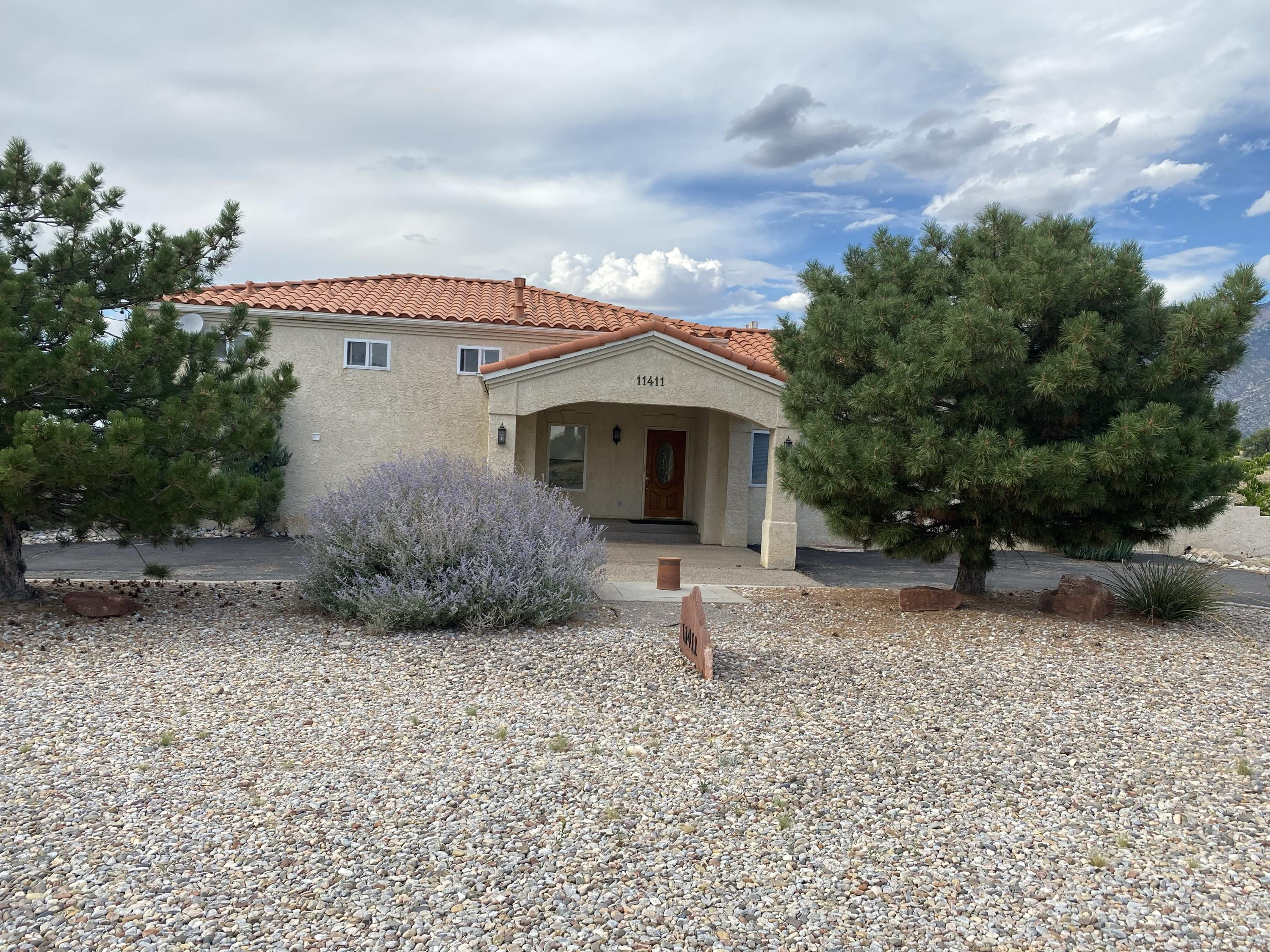 Wide open panoramic views. In county but close to town.  Huge MBR suite with fireplace,  hers and his closet with laundry upstairs.   Downstairs has Large game room and TV room with bar with 2 br & 2 ba and laundry & study.  Would be a nice multigenerational  arrangement.