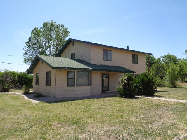 Rare Find--County House in the city.  2-story house on 2 acres in the valley!  The living room has a pellet stove and the formal dining room is off the kitchen.  The large 4th bedroom is downstairs.  Master bedroom plus 2 bedrooms are upstairs.  Property is cross-fenced and has some facilities for livestock.