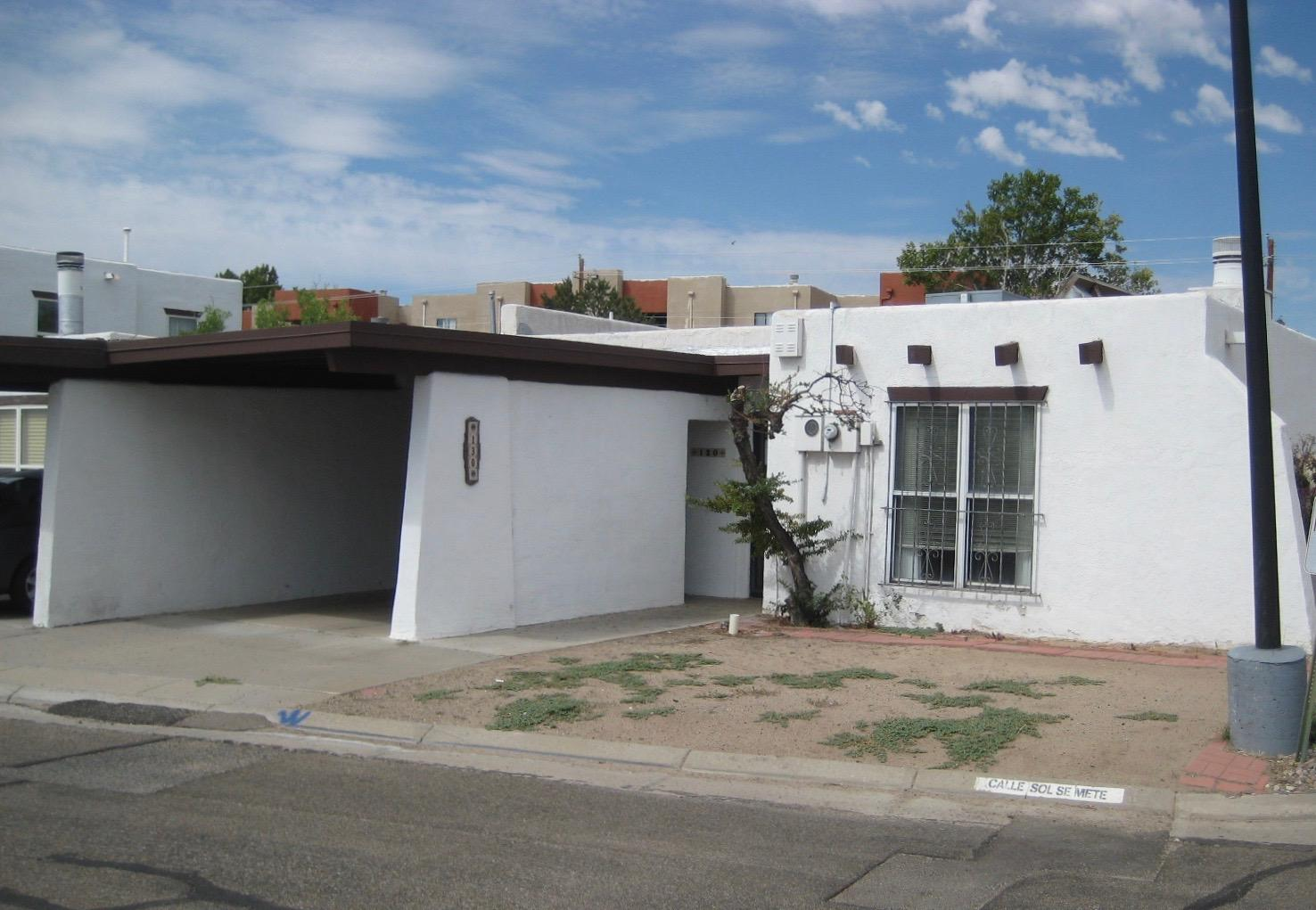 This Corner lot Town Home features 2 bedrooms, 1 3/4 baths and is approximately 1100 square feet. It's the Perfect Opportunity to own a home in one of Albuquerque's hidden gems! Villa De Paz Town homes offers affordable living in a very central location, only moments for every conceivable service!!   Needs a Little TLC. The complex has a Community pool and play ground for kids of all ages! ***No warranties or guarantees expressed or implied! Buyer to pay for their own Inspections for Buyers knowledge only!*