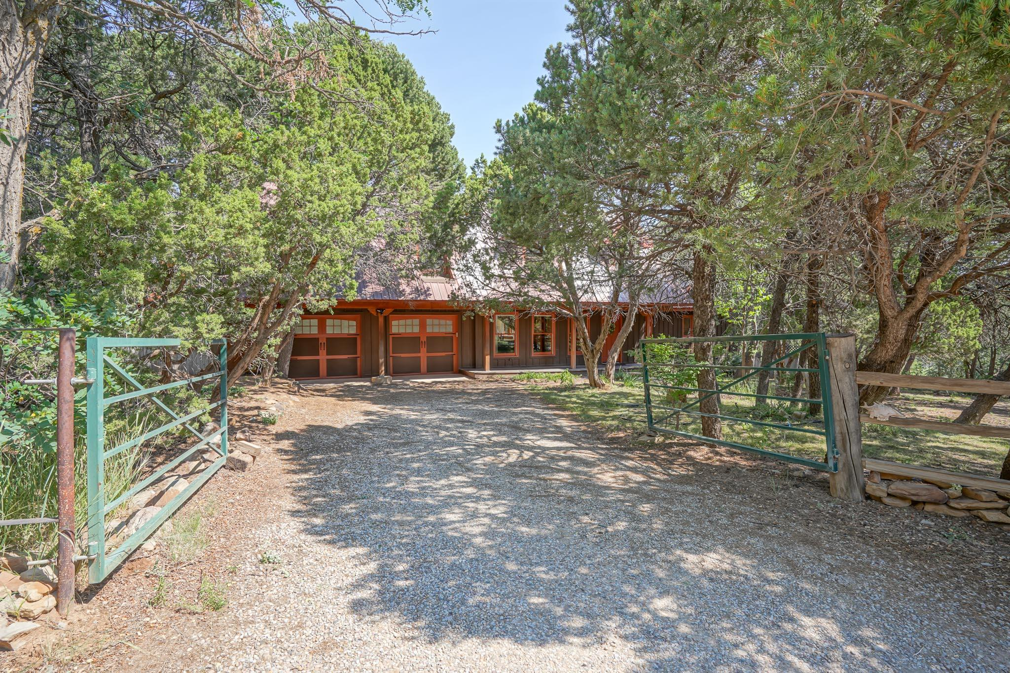 One of a kind Classic 1-1/2 Story Cape Cod on 1.63 acres of wooded privacy, 3 beds, 3 bath. Rustic 2 story 'bunk guest house' w/ kitchen, 3/4 bath, bedroom, gathering room w/ wood stove. 3 stall Vintage Style Barn, hay loft, tack area, drive thru rolling barn, paddock and 1/2 acre rec grazing area. Old fashioned Garden Shed on stone foundation. Main home features heating Soapstone and Vermont Castings wood stoves, wood beams, wood windows, bright open kitchen, pine 6 paneled doors, built in book cases, tall wood mop boards, wood coving, wood ceilings,wainscoting,  red oak wide plank floors, expansive decks and master balcony. Perfect multi-generation house and property. Sierra Vista Estates Community Water, Close to local shops and services plus quick access to I-40, ABQ, AF base, APO