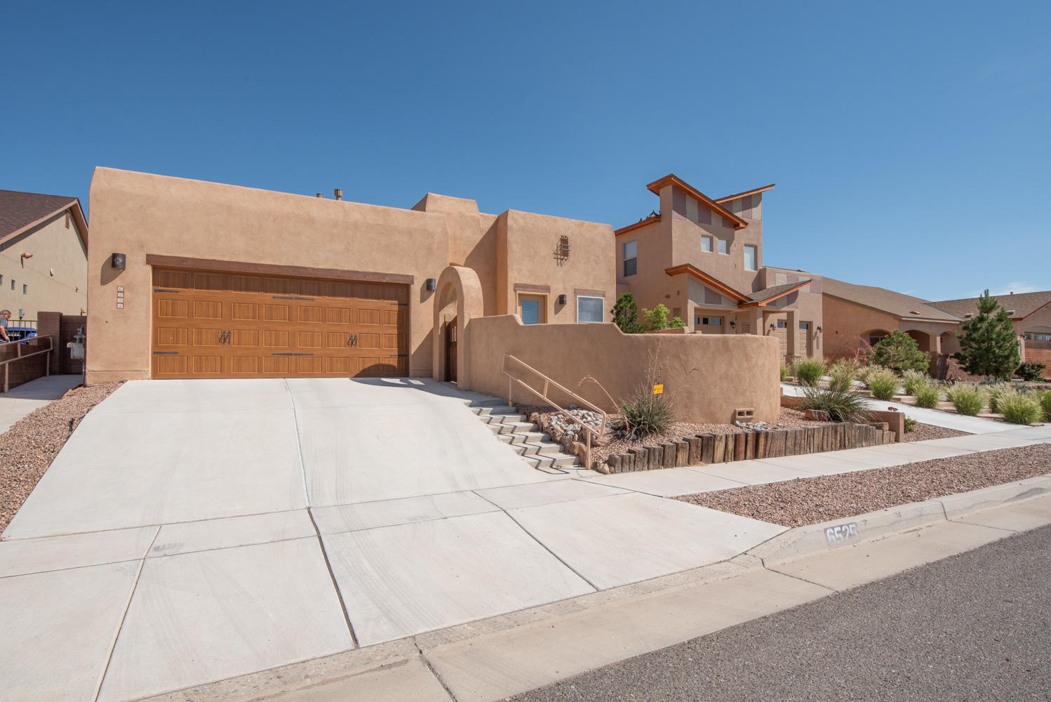 Pristine 1 story Tiffany home with enclosed (walled courtyard), with unobstructed views of the Sandias. This is your next home with, new stainless steel appliance (with warranty-2019), pull out drawers inside kitchen cabinets, RO system(2019, new custom finish garage door (2019), water softener, one year old ION Photovoltaics Solar system (owned by seller) plus Low-Windows for amazing energy savings . This home is also handicapped accessible , with a front bedroom (with ramp and door) to an open courtyard. Beautifully landscaped backyard with water feature (flowing like a river and new pump).There's more, lighted nicho's, beautiful ceiling fans, skylights, jack and jill bathroom, huge pantry, utility room, beams and corbels...even 220 V in the garage. Kitchen opens to the great room.