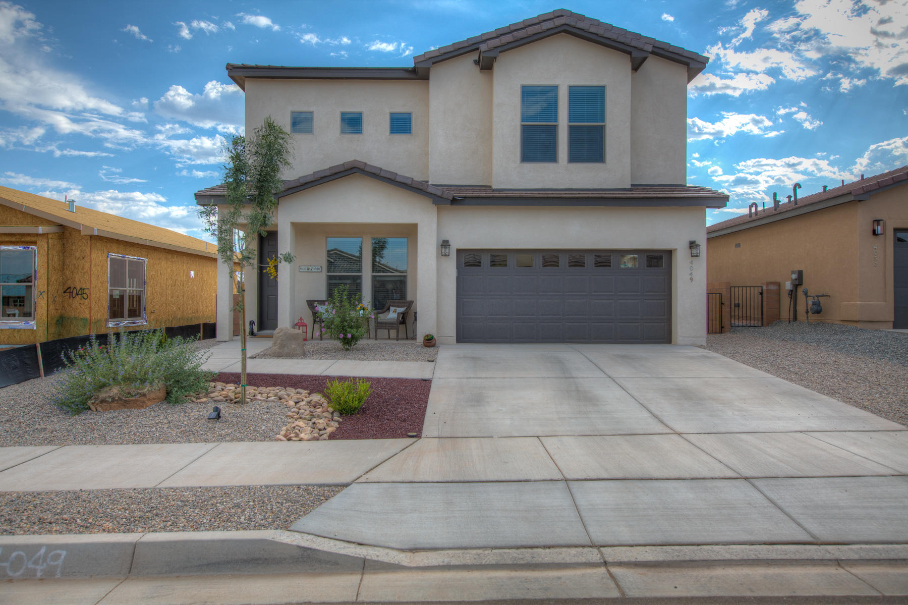 Stunning newer construction with lots of bells and whistles. Enjoy this open floor plan home with gorgeous kitchen lots of cabinets and storage. Beautiful grey cabinetry and stainless steel appliances, quartz counter tops, large island. Built in coffee bar, butlers pantry plus large walk in pantry. Tons of extra storage. Down stairs has office/ work out room or 5th bedroom. Up-stairs enjoy 4 bedrooms with great owners suite glamours spa like bathroom with big walk in shower. His her sinks, large walk in closets. one of the secondary bedrooms has it's own bathroom perfect for teen or in-law. The other secondary bedroom has access to shared bath directly from the room. Shows like a model home. Fully landscaped with views of the mountains sit outside under the gazebo. Make this a must see.
