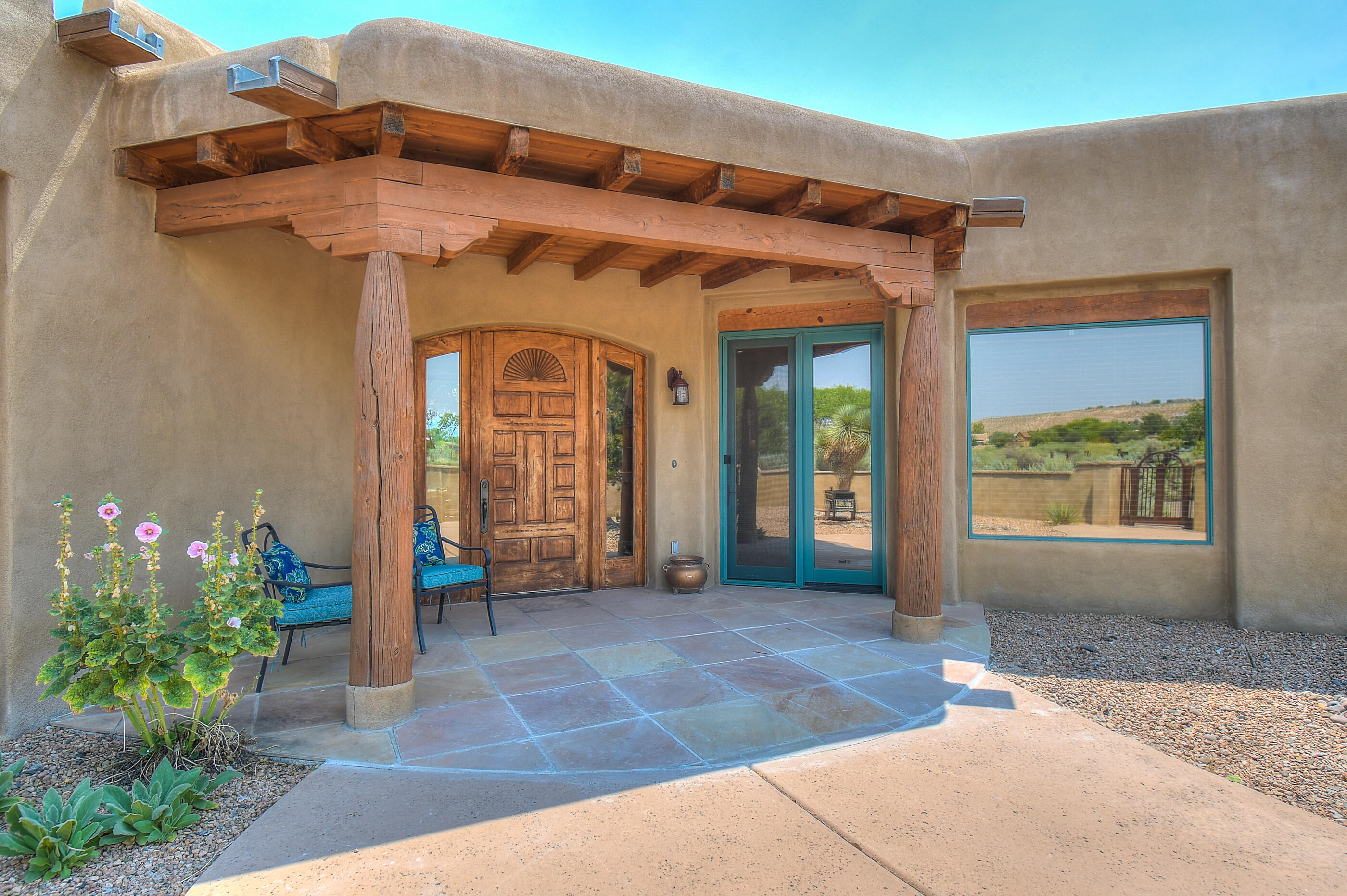STUNNING SANDIA MOUNTAIN VIEWS!   Chef's Gourmet Kitchen. Custom Designer Touches Throughout.  Vaulted Ceilings.  Open Floorplan.  Attached 815sf MIL unit.  4 bdrms/4 baths/Separate Entrance Office.  4100 sf.  Huge Outdoor Living Spaces with Views and Landscaping