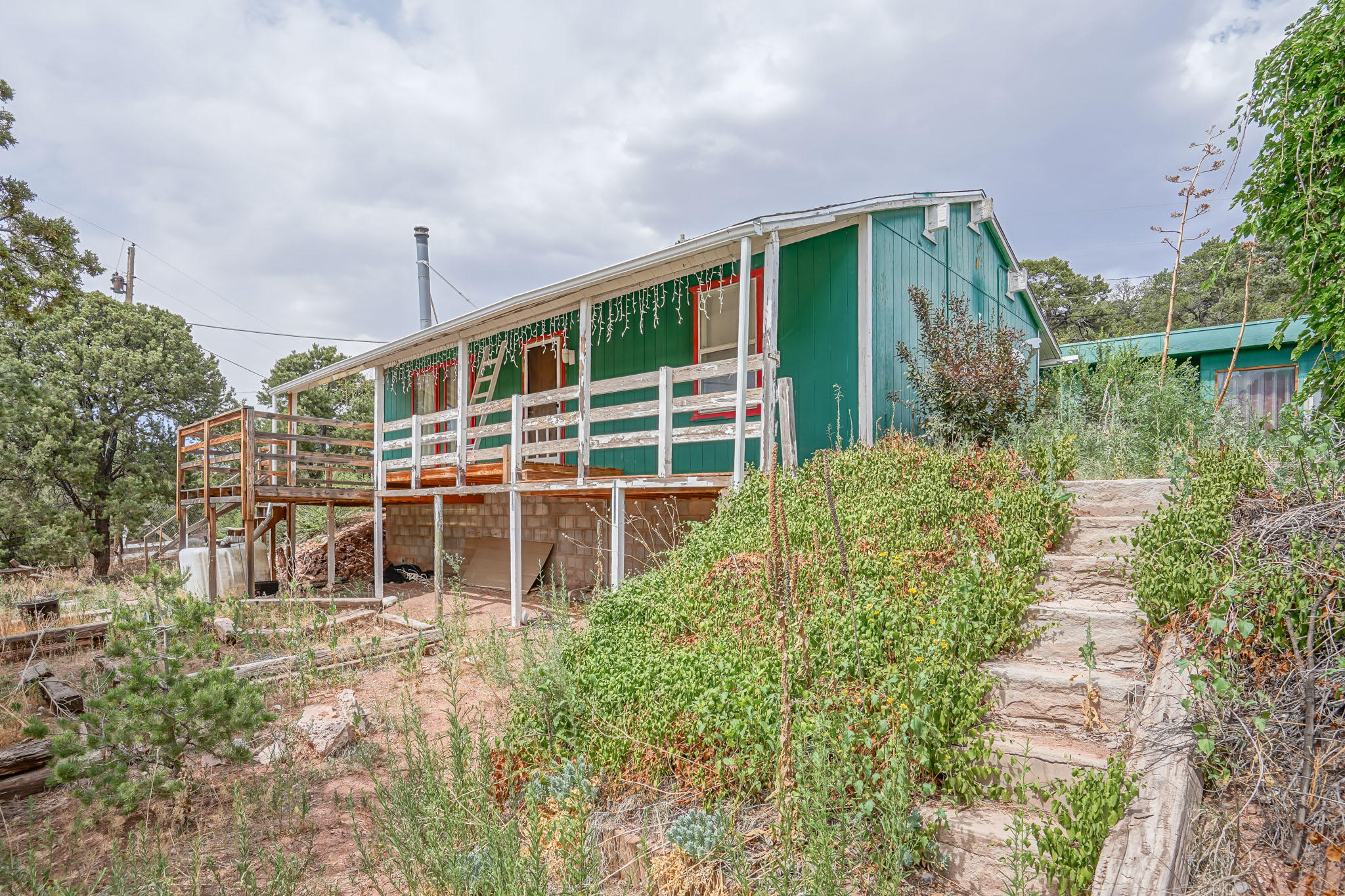 Come see this great home with 4 bedrooms and 2 bathrooms in the East Mountains with the most amazing views.