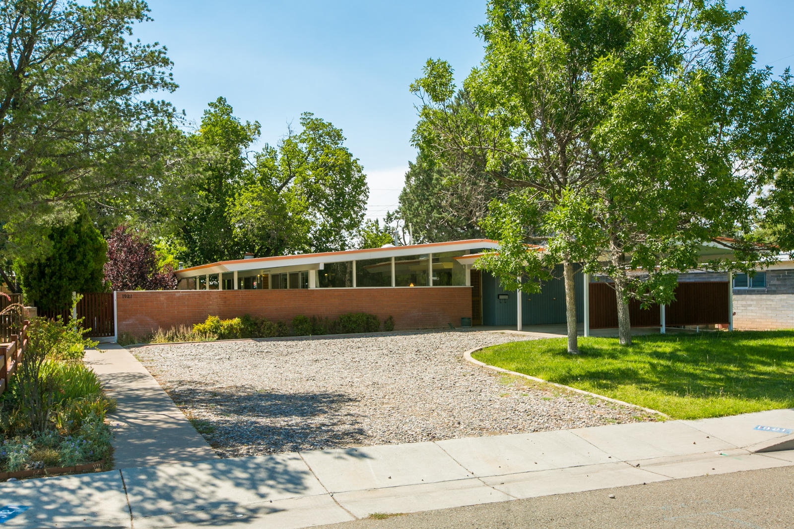 Rare opportunity to own an historically and architecturally significant Mid-Century Modern designed by well known architect, Don Schlegel. Incredible natural light from the wall of windows and total privacy from a well-positioned south facing yard. Move in ready for the purist who wants to retain it's true character. Original features include hanging lamp in the living room, floating fireplace mantel, Chambers built-in cooktop, original wood paneling, floating kitchen cabinets, countertops, bathrooms and more. It even has some of the original paint colors. Light blue ceilings bring the outdoors in and the unique yellow ceiling tray has hidden lighting to feel like sunshine. Systems updates include furnace, HWH, dishwasher, oven, plumbing and soon the electrical panel.