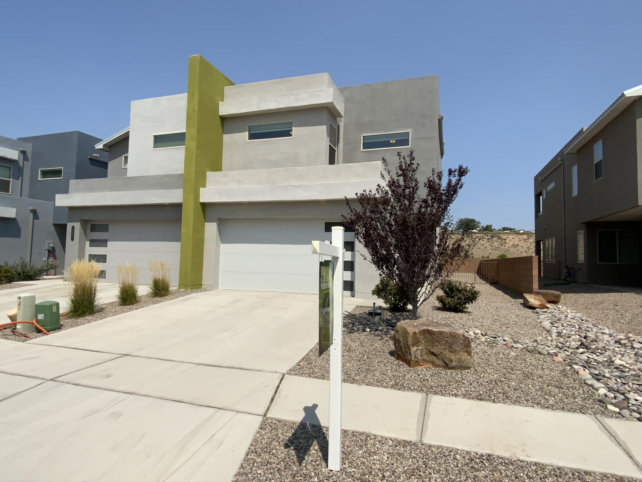 Time to upgrade to this beautiful contemporary town home community in Volterra!  Priced to sell quickly!  This propety is a New Mexico Silver Certificate green construction by DR Horton! Features include; granite, 2 zone refrigerated air (upstairs / downstairs), tank-less / never ending hot water, 2x6 construction, Low-E vinyl windows, LP Techshield radiant barrier roof sheathing, Blown-in/ packed insulation, rebar reinforced foundation, Taexx pest control system, dual lavs, closet plus organizing system and much more!  Private bridge connects community to civilization which is surrounded by incredible views and open space trails!