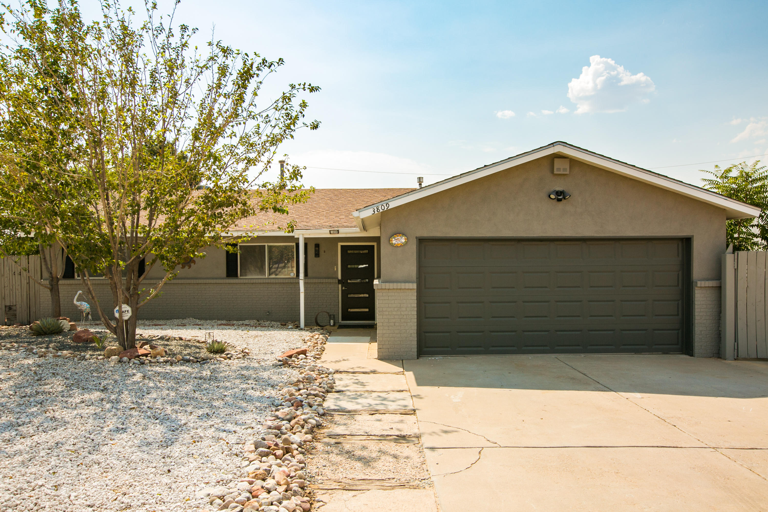Featuring a well maintained 3 bedroom 2 bath home sits on a .22 acre lot and offers an open floor plan. New paint throughout, new HVAC system, new front door, tankless water heater, Panel upgrade, plus a 584 sq ft. shop rewired, new security and porch lights, zero-scaped, new fans in the sunroom and great room, new water shut off valve in garage and new garage remote. Beautiful faux wood flooring, bullnose finished granite, and cultured marble surround showers. A spacious great room has a warm and tranquil retreat with wood finished ceilings and walls, comfortable bancos and a kiva pellet stove to provide relaxation, rest, and entertaining. Great central location to all amenities.