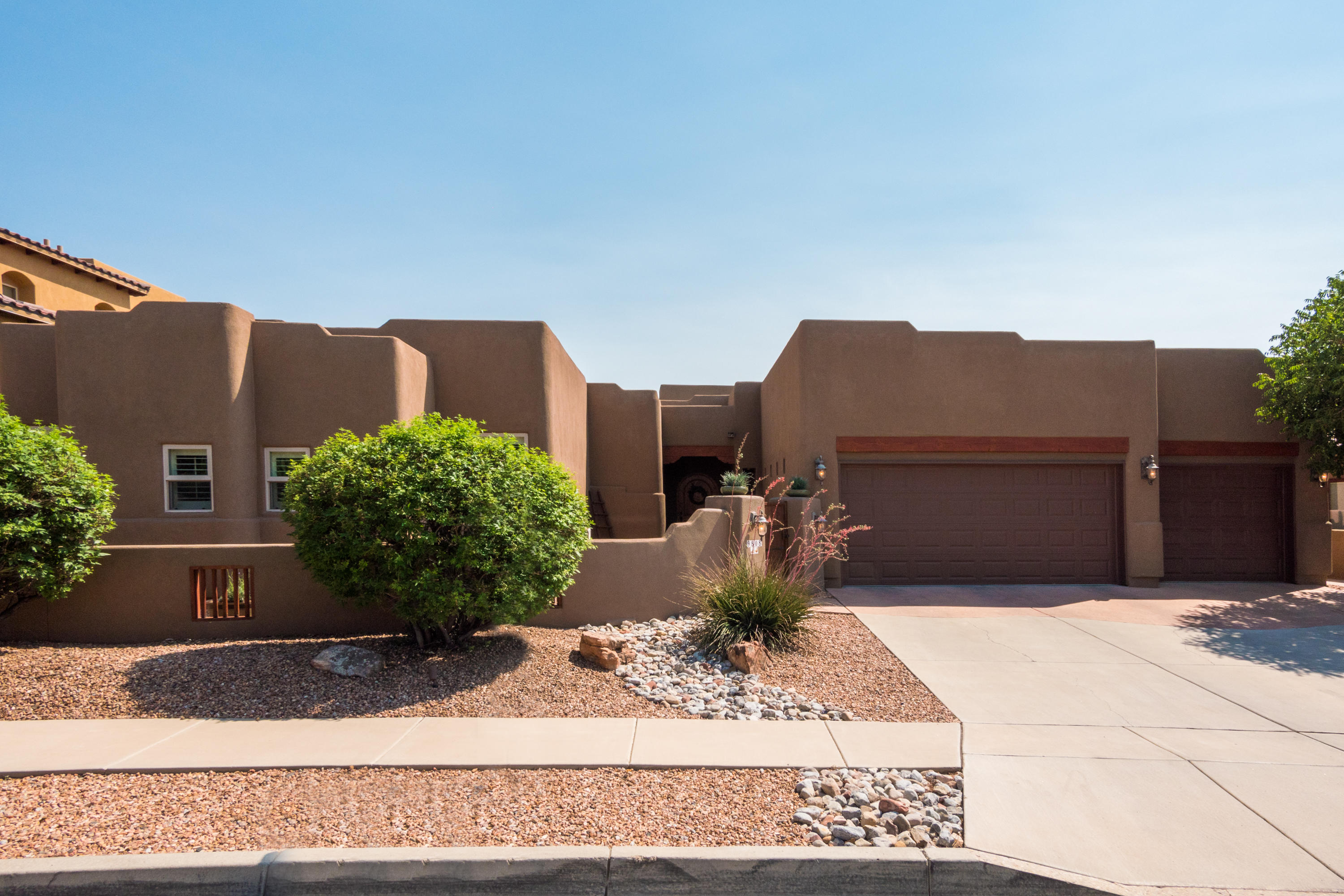 WOW, Custom home in exclusive Ocotillo gated community in North ABQ Acres now Available! Over 100k in upgrades make this home a show stopper! You'll be impressed with the Stained concrete floors, stacked stone, hardwood kitchen cabinets, granite countertops, unbelievable masters suite w/bonus room connects to outdoor pergola, 2 wet closets in master bath, mountain views, skylights,  built-in nichos, well balanced open concept floorplan,  plantation shutters, Hunter Douglas smart blinds, Omni-Cote variance, smart thermostat, covered patio w/ stained concrete entertaining area, lush landscaping, private front courtyard, 2 fireplaces, en suite bathrooms for each bedroom, new paint/trim, large pantry/mudroom and soo much more! Unbeatable area and amazing home ready for new owners! Let's Move!