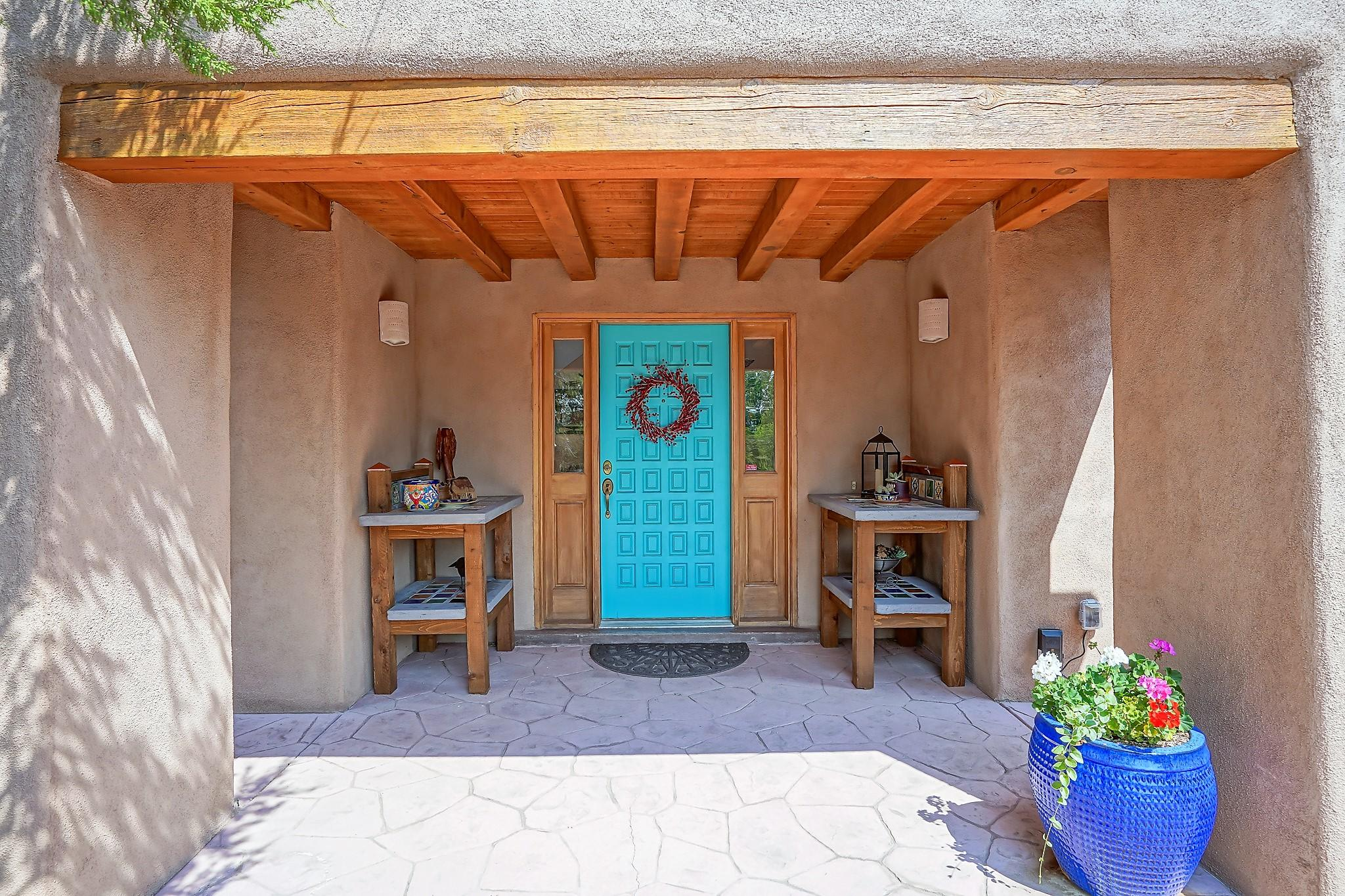 This is a custom southwest style home located in prestigious Paa-Ko mountain community on a one acre lot. This home is a member of the recreation amenity which includes swimming pool, tennis, and bocce courts.  There is a nearby gymnasium run by the county with modest membership fees. Water is supplied by Entranosa Association. Only twenty minutes to Albuquerque, 40 minutes to the airport, and less than one hour from Santa Fe this custom home is the ultimate in affordable luxury. Excellent condition! A must see!