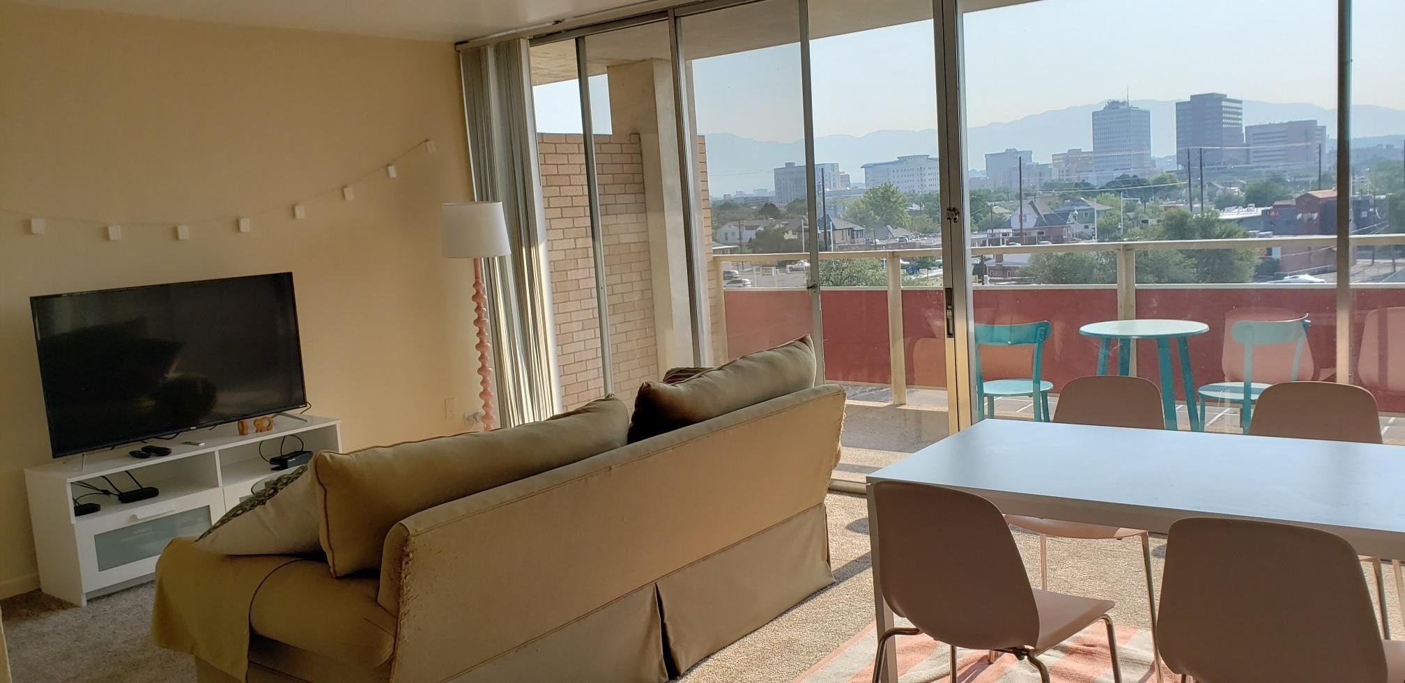 VIEWS, VIEWS, VIEWS! This Downtown Condo features a large Balcony to enjoy the Views from. This Condo is facing East with Views of Downtown and the Sandia Mountains. Very spacious, light and bright. The HOA dues cover all utilities, one reserved covered parking space, pool, exercise room, and so much more--see attached Facilities/Amenities list.