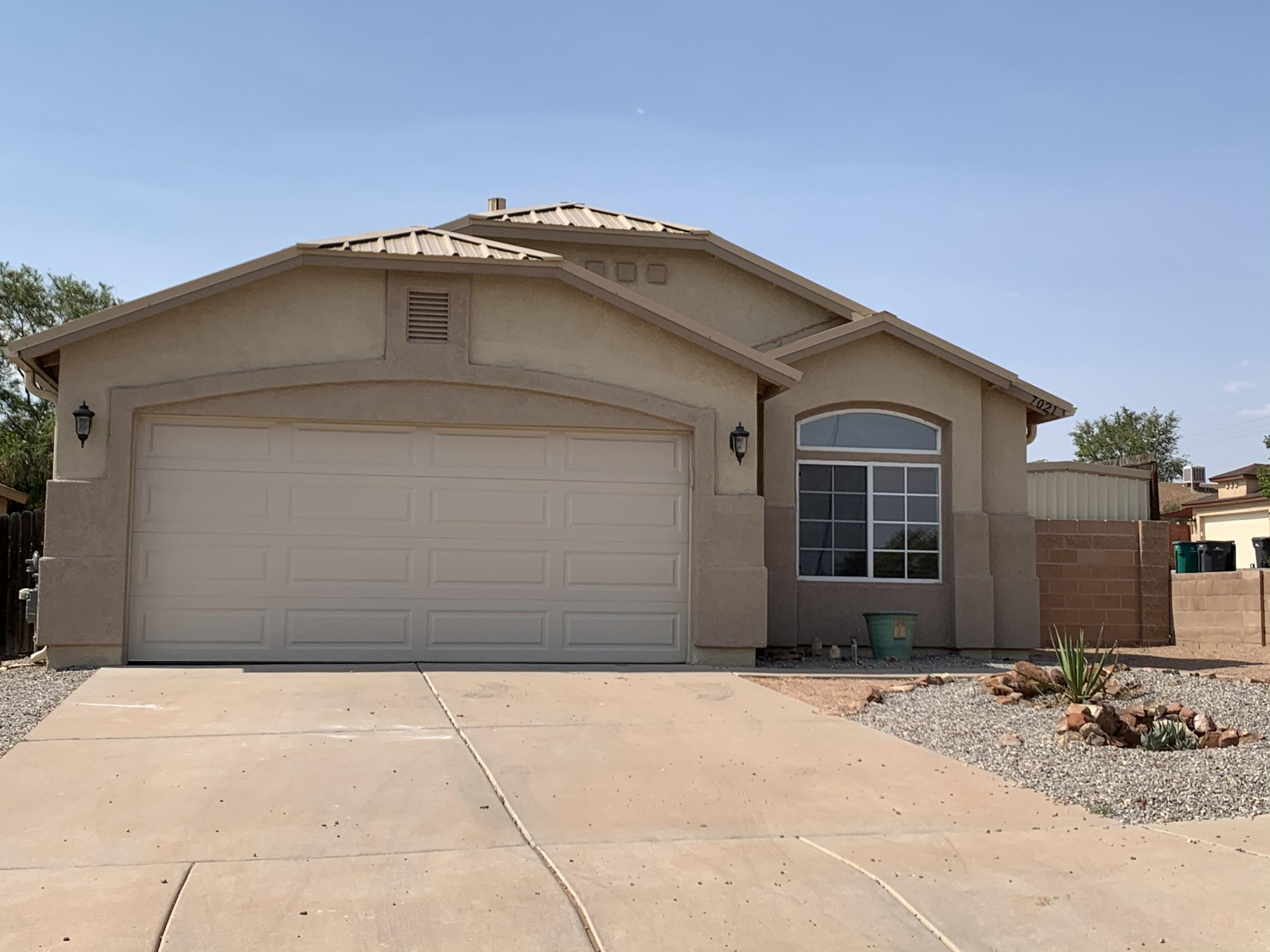 Corner Lot! Shed with electricity conveys! New water heater! New Metal Roof!   Wood Floors! Wood Blinds! Travertine Tile in MBA & Laundry Area! Stainless Steel Microwave & Stove! LED lighting in the entry & dining room! Tiled Hall Bathroom! New Toilets! Fresh Paint! Seamless Gutters! Front Yard xeriscaping! New insulated garage door, pad & belt! Brick wall & custom gate! Sidewalked! Waterfall feature! Built up patio! Dog run & fencing & cement walkway! Raised up planter beds! New LED solar outdoor lights! ELASTOMERIC stucco paint with lifetime guarantee! Front & Backyard Moss rock! Top of the line Trane a/c with allergy filtration and wifi humidity control!