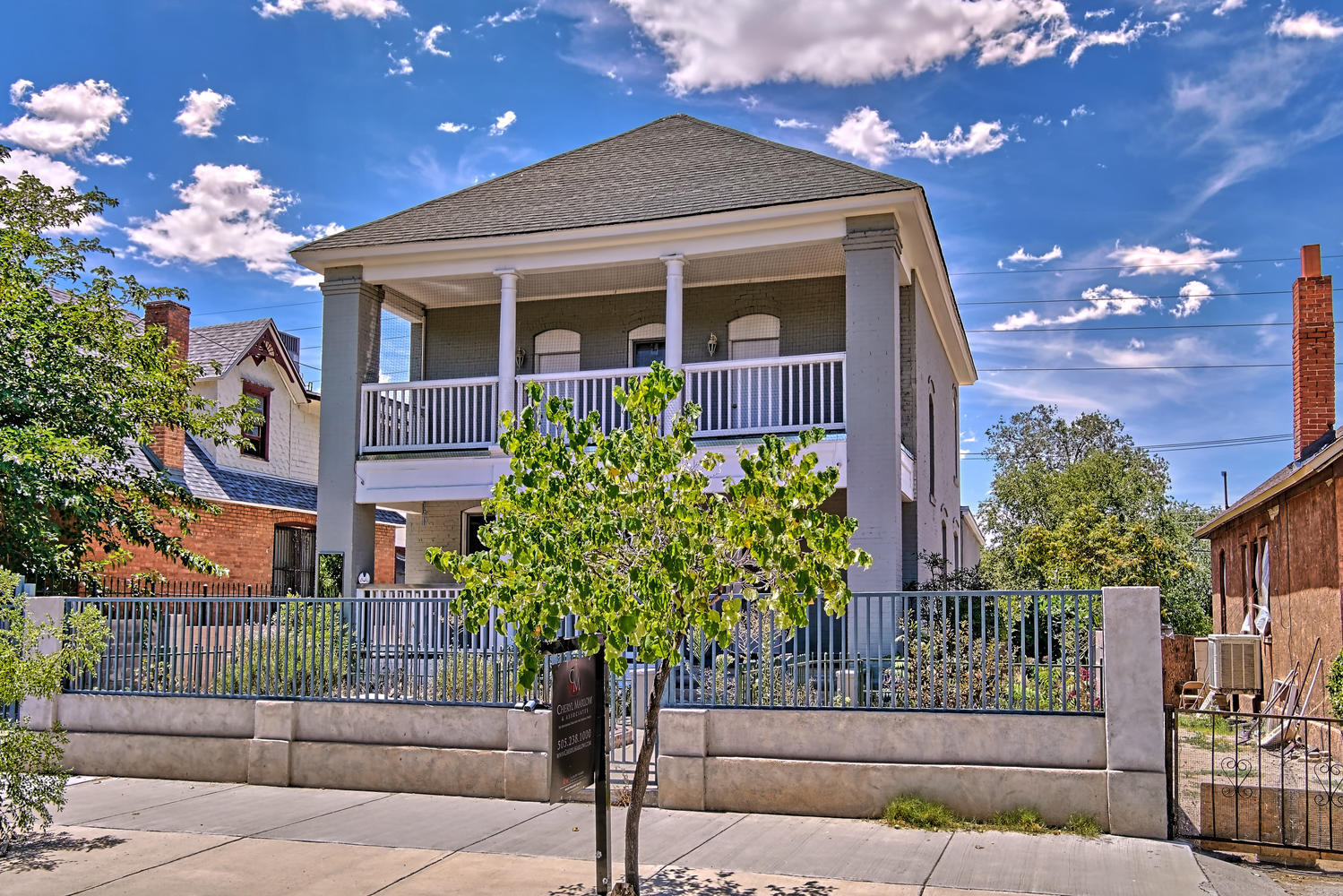 Beautiful home w/ Victorian details in Historic Hunning highlands neighborhood!Gorgeous hardwood floors invite you into the spacious LR,DR,FR heart of the home.! Fresh paint through out! Updated kitchen features abundant cabinetry/plant bay window over the sink/tile counters/high end 4 burner wolf range plus griddle! Large Eat in kitchen area w/bay window! LL has storage space for ideal for Wine or home canning. 2nd UL has dual owners suites & a huge patio cover deck off east BR. Third level with dormer windows could be BR, home office or whatever you desire and offers a 3/4 updated bath. Rear yard offer spacious bricked open patio fire place and A HUGE workshop w/ abundant storage/shelving/& room for anything! Close to UNM, Hospitals & all that Downtown has to offer!