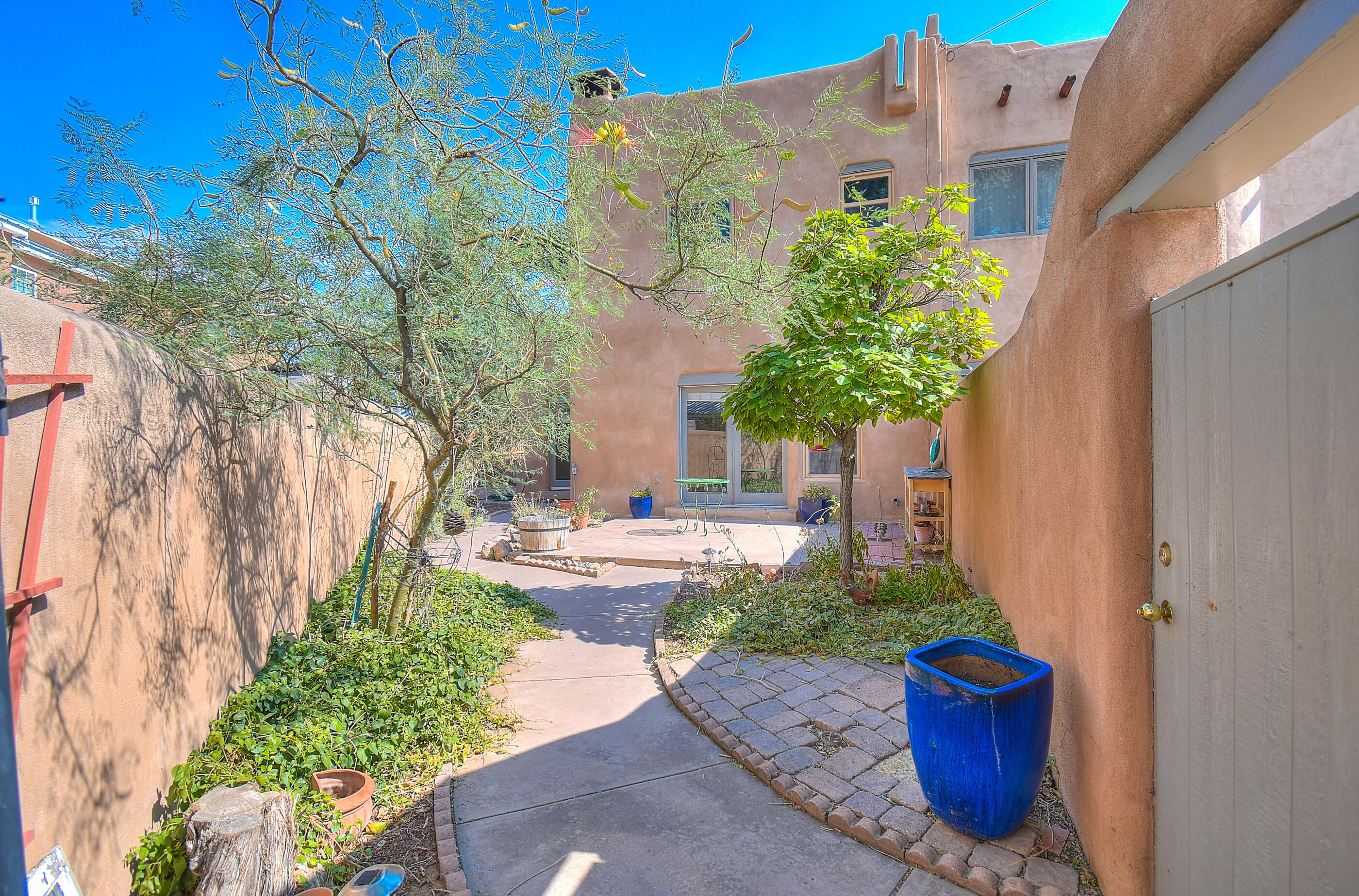 This unbelievable Old Town location is close to the bosque trails, galleries, Nature Center, restaurants, & museums. Beautiful, Private courtyard entry & french doors to garden. Open floorplan with brick floors, 2 kiva fireplaces. Enjoy your master suite with a deck &  high ceilings, beams & korbels. Don't miss out on this one!