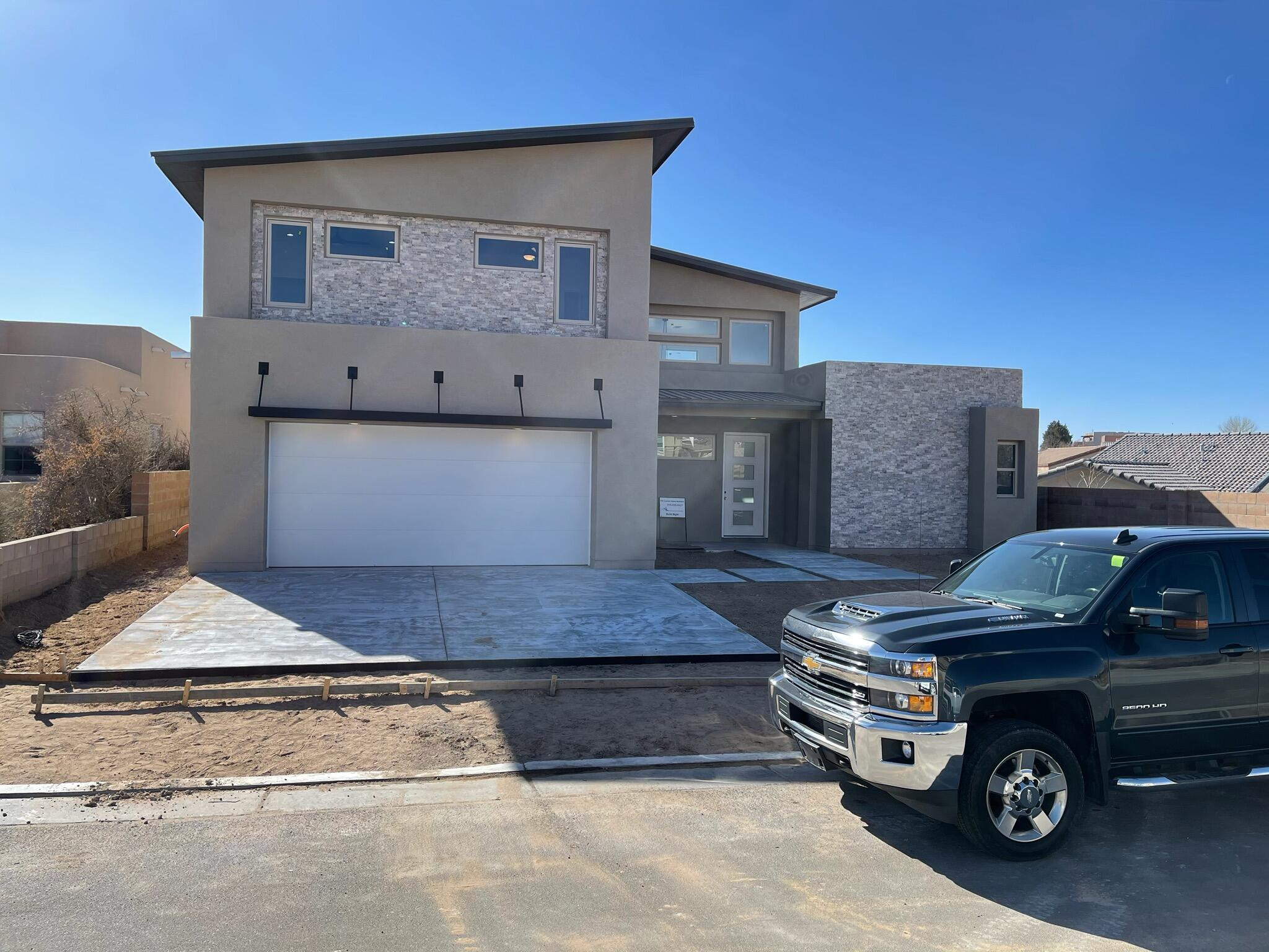 AMAZING new custom home under construction in the Knolls of Paradise community! Home features all the extras with upgraded appliances, expansive spaces, outdoor fireplace to enjoy while experincing the beautiful views.  All this while being located only a couple of minutes from Cottonwood Mall, Paseo Del Norte, Rio Grande Bosque and much more.. Master suite on main level. Covered patio and walled backyard.MUST see to appreciate this modern styled beautifully designed home.