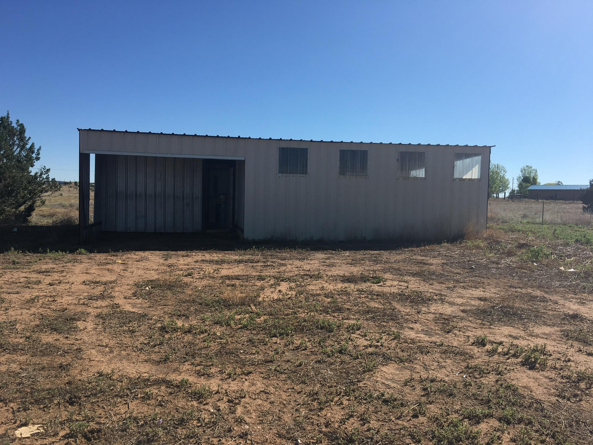 Totally remodeled 3 bedroom 2 bathroom with large 2 car garage and barn.  Sit on just over 6.24 acres wooded and nice flat areas for livestock. One of a kind