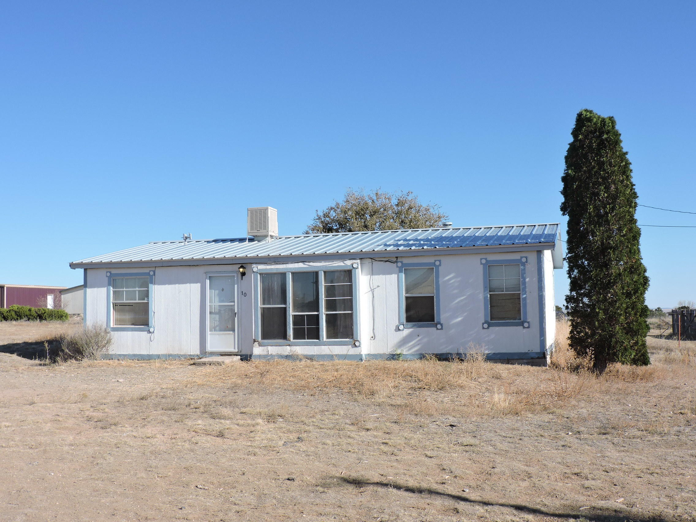 Doublewide home on 3/4 of and acre.  Appliances stay, property completely fenced, with a storage shed.
