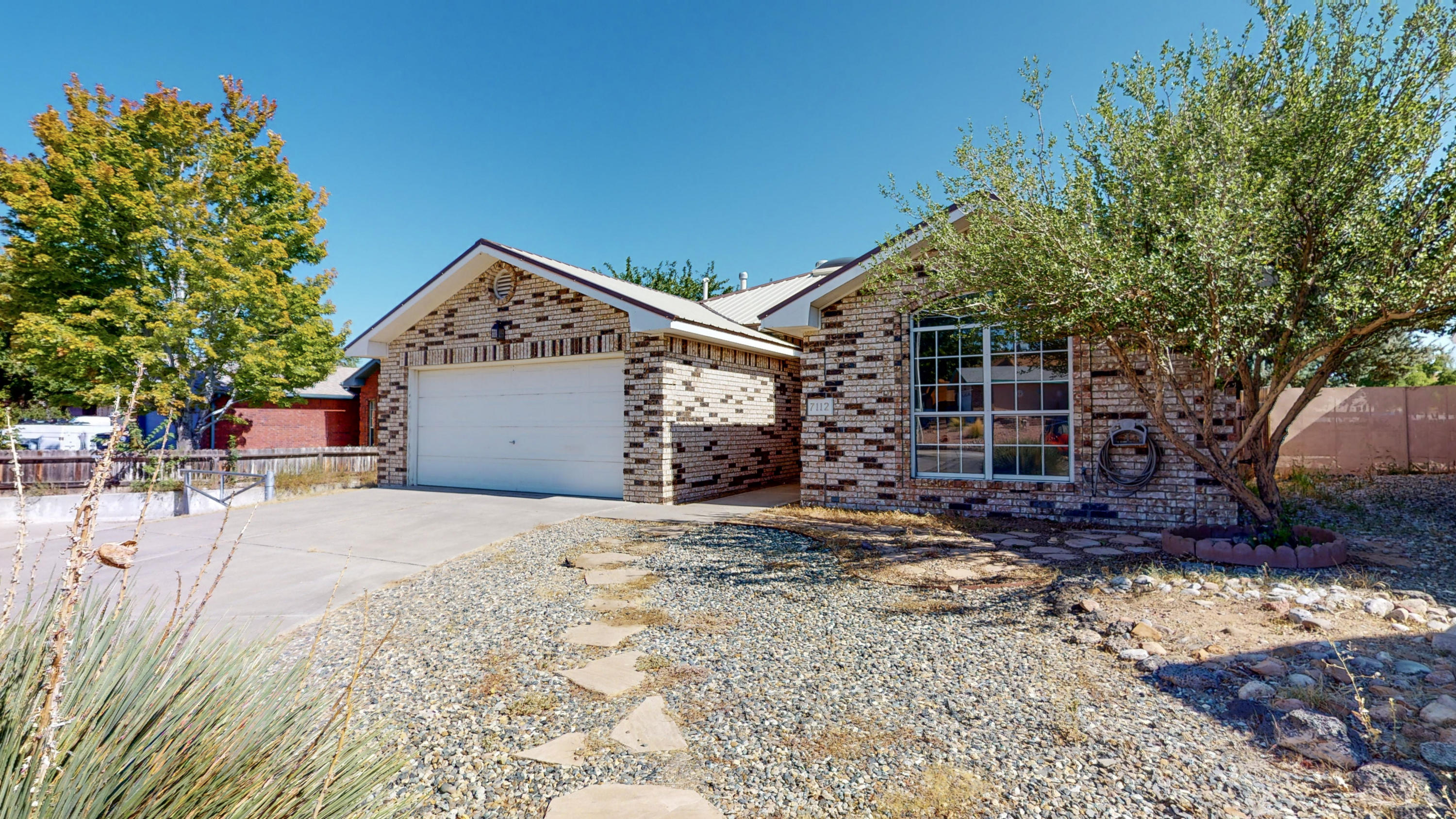Multiple offers received!! OPEN HOUSE Sat 9/5 1pm - 4pm .This Opal Jenkins Gem in Taylor Ranch features a Metal Roof, Brick Exterior, and some Xeriscape. Walk in and find the Raised Ceilings and Open Living Area with tons of Natural Light from Large Windows & Skylights, along with a Gas Fireplace with Wood Mantel above. As you continue on in the home, you will find a Galley Kitchen that features Stainless Steel Appliances and Granite Countertops with Tile Backsplash. Master Bedroom is stacked with Vaulted Pitch and Ensuite with Double Vanity, Tile Surround Bath, and Large Walk In Closet. You will find Tile Flooring Throughout Excluding your 2nd & 3rd bedroom which features carpet. upgrades include a Newer Refrigerated Air & Furnace, Water Heater, and Dishwasher. Schedule to TOUR today!