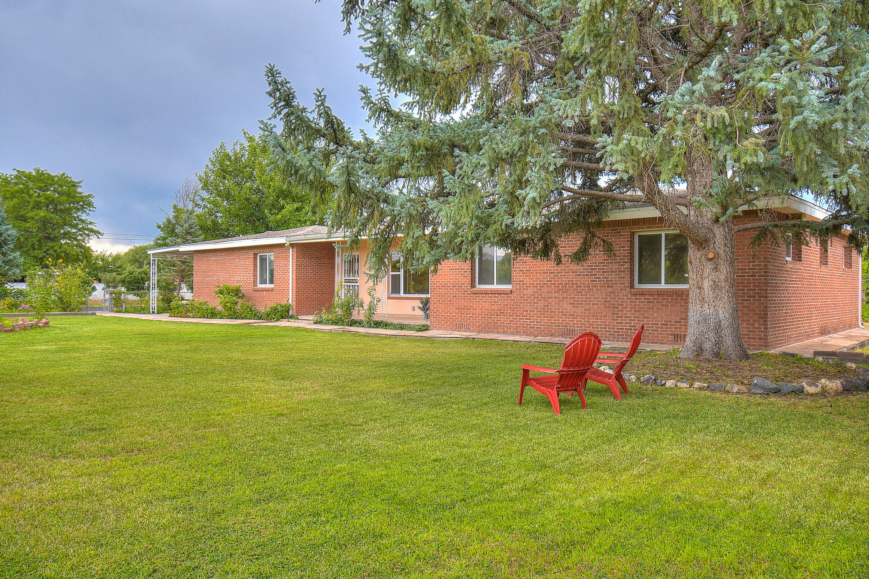 Private, Fully Enclosed and Gated Accessible Country Living.  Gardeners Dream. 1.45 Acres with Mature Apple Trees.  3 Bedrooms, 4 Baths, 3 Car Garage.  Fully Upgraded Bright and Airy Eat-in Kitchen.  RV Parking.  MRGCD Irrigation.