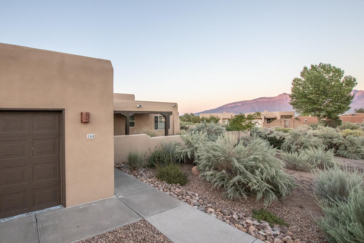 BACK ON MARKET! Nicely updated 4 bedroom/2.5 bath home on .96 acres in Corrales. Beautiful Sandia mountain views from living area, kitchen, primary bedroom and covered patio! Home has newer(2018) water heater, new refrigerated air and furnace, new silicon roof with transferable 20 year warranty, new stucco, upgraded septic, new carpet and paint, new wood and fabric window treatments, new kitchen/laundry appliances that ALL convey. Updated landscape and drip irrigation system and all porch posts and beams have been replaced.
