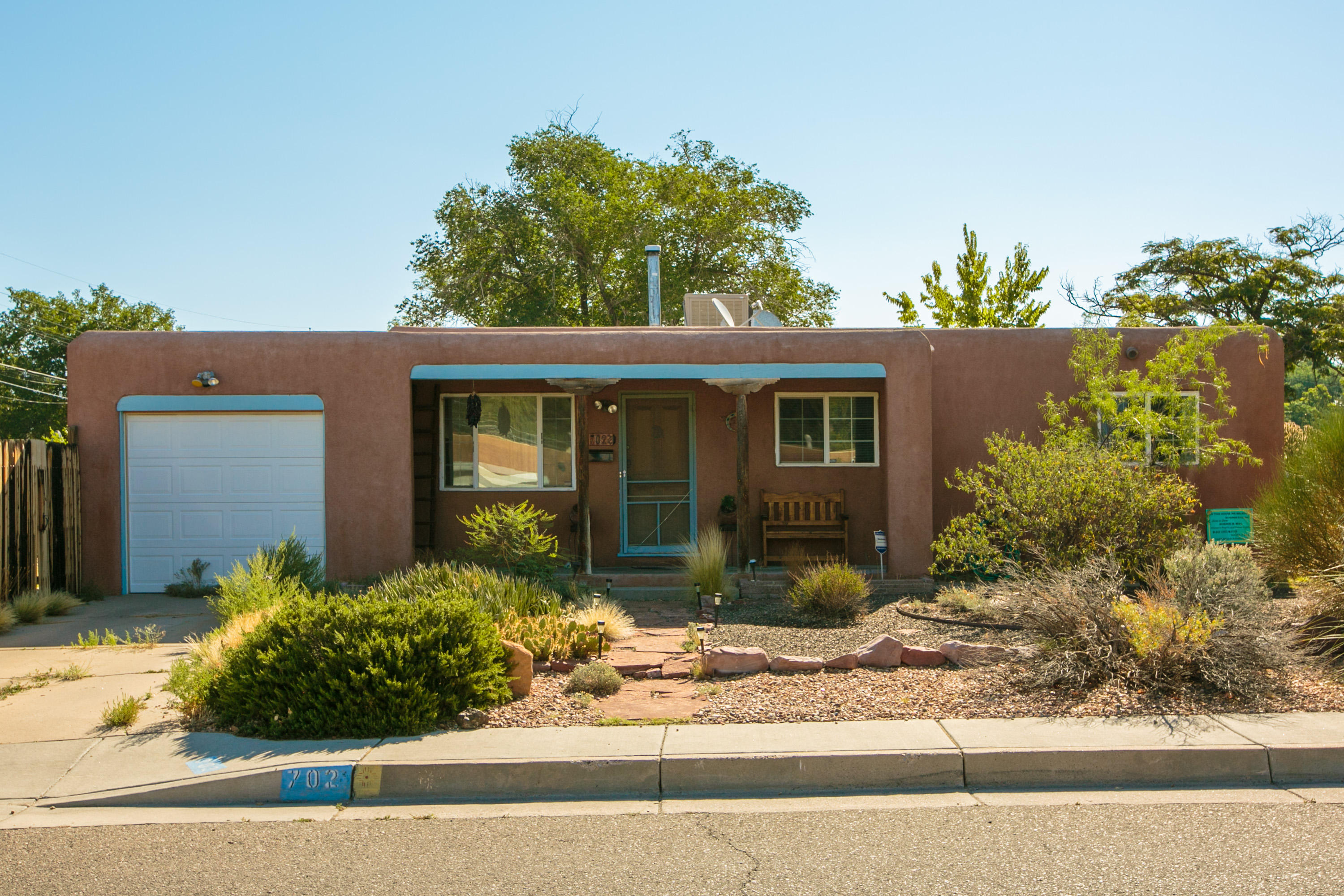Charming home on corner lot with backyard access, Wood floors, tile in kitchen and bath. Newer hot water heater and evaporative air within the last 2 years. Washer/Dryer/Refrigerator included. Quiet, established neighborhood, close to UNM downtown, nob hill.