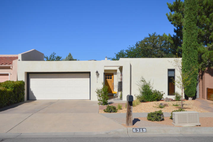 Such a beautiful townhouse!  Come and be impressed with the complete remodel of this Mossman-Gladden patio home in Bear Canyon.  2018 Sq. ft. of luxury  Wonderful kitchen with white cabinets, granite counter tops and top of the line SS appliances !  Two living areas...Living room - dinning room combination w/fireplace plus cozy office/den.  Quiet area close to Albuq. Academy, Tanoan Country Club, JCC, Whole Foods Arroyo del Oso golf course and many other restaurants and services.  Lovely and large back yard with grass and trees...covered patio.  New heated and air conditioned sun room by Champion.  This is one of the nicest townhomes I have seen in this area!!!!  Quality throughout and so livable!