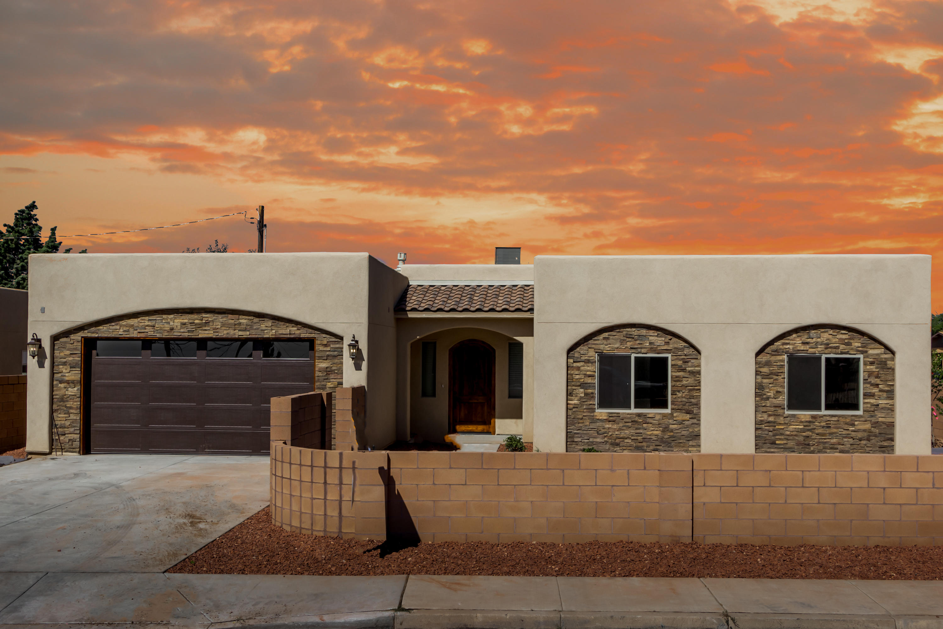 Beautiful single-story custom new build home with top notch finishes. This home features an open floor plan with 10' ceilings, custom knotty pine doors, gas kiva fireplace, and 2 master bedrooms! Kitchen boasts custom hickory cabinets, granite countertops, SS appliances, & breakfast bar. Tile floors throughout with custom tile work in the bathrooms. Laundry room has custom cabinets, granite countertops & folding area. High efficiency refrigerated air to keep you cool during the summer. Lovely private covered patio leading to the backyard. This well appointed home with split master floor plan is sure to impress. Schedule your showing today. *Photos and floor plans are of proposed construction, and may differ slightly.