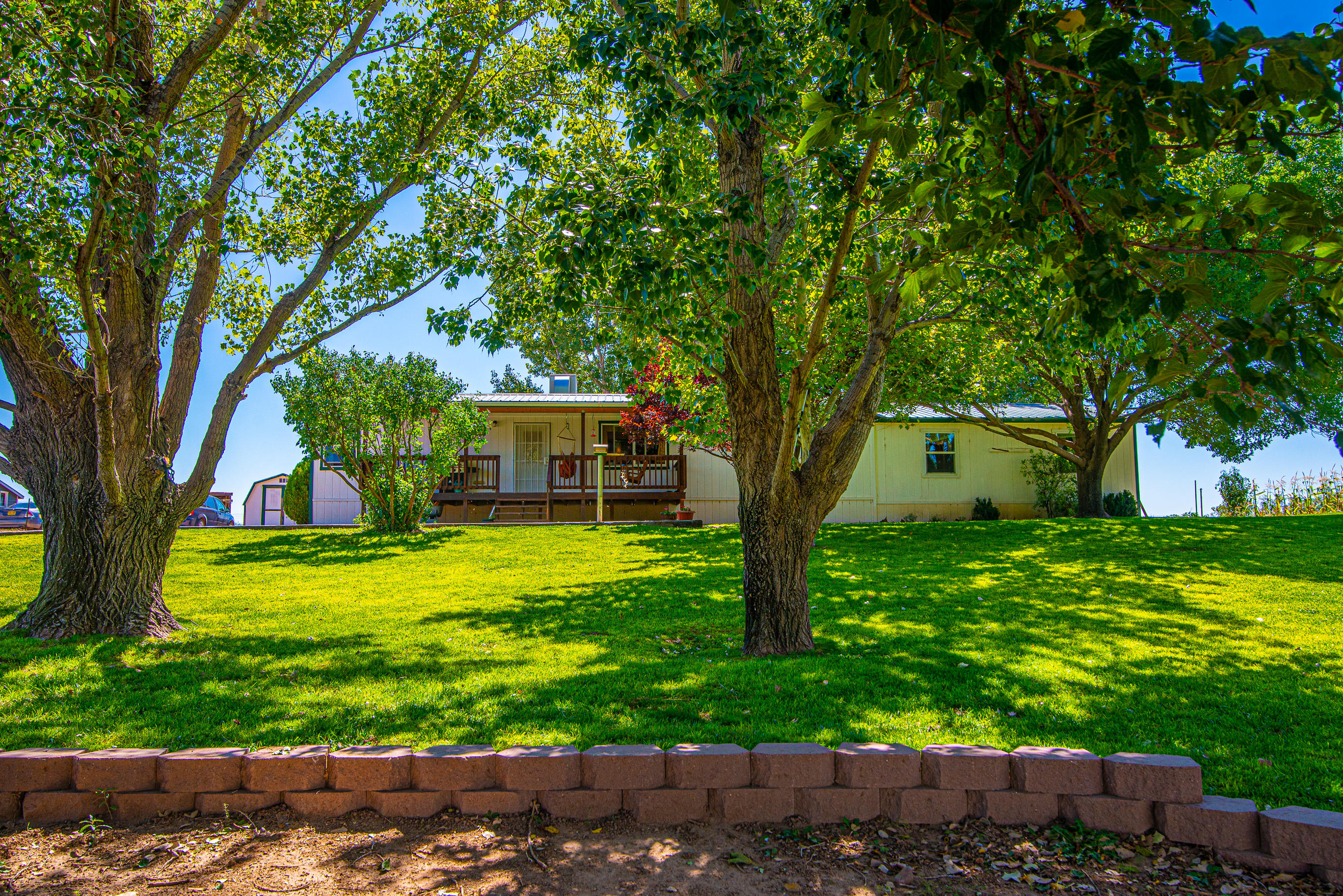 County living at it's finest! Come see this wonderfully kept home sitting on 1.25 acres. This home has plenty of space, two living areas, formal dining area and open kitchen. Covered porch, manicured grass, storage shop with workshop area. Views to the east!