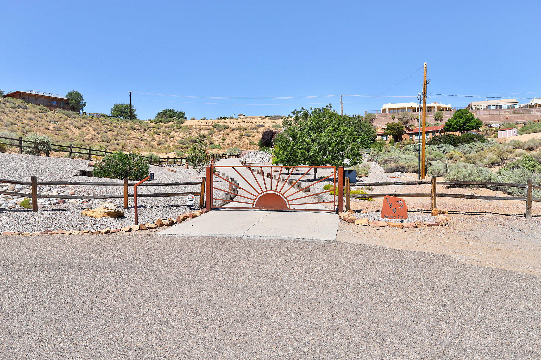 Beautiful custom Rachael Matthew home with views to die for! Perfect location at the end of the road-drive up thru the gate onto your fenced and landscaped acre lot to your private oasis. Wonderful open floorplan greets you with windows to the patio and extensive views. Spacious great room with raised beamed and Latilla ceiling, open to the kitchen and formal dining room. Ample counter space and island too. SS appliances, lots of cabinets & pantry too. Wine cooler, tile floors throughout the entire house. The patio feels like a 2nd living area-very lush with waterfall, very private, and an outdoor kitchen!  2 nice size bedrooms down, wonderful master suite upstairs with private view and relaxing deck.  Spa-like master bath!  Add a 3 car garage and you've got your Southwest Oasis!