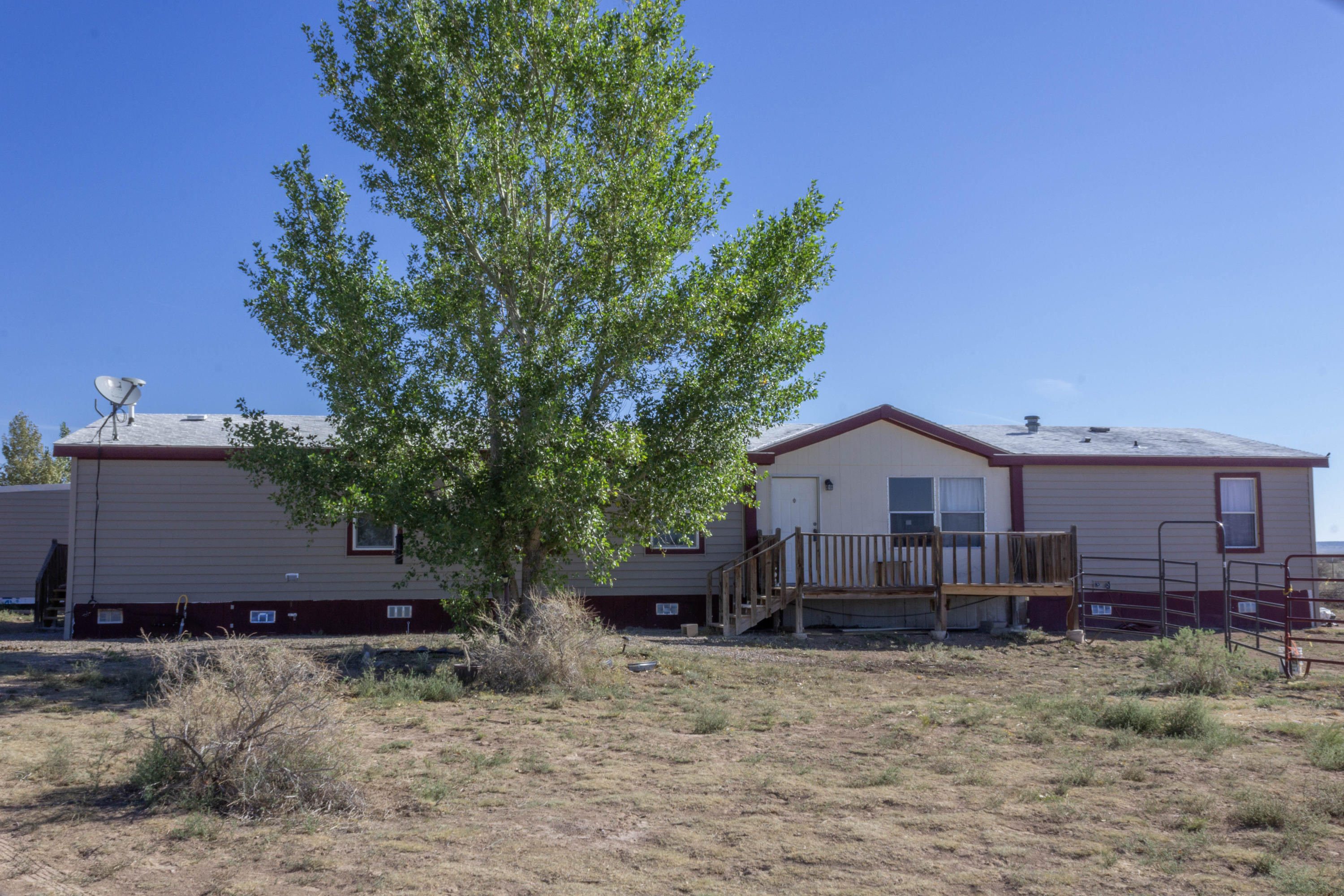 A great deal on an affordable piece of county living!  Large home with a great layout.  Two living areas, huge pantry, office, hobby room, electric fireplace, natural gas, state of the art water filtration system.  Fully fenced 2.5 acres.  Beautiful views to the west as well as out to the east.  This house has had some wonderful recent upgrades and updates and will make an amazing home and potential great horse property on your very own slice of New Mexico's wide open country!