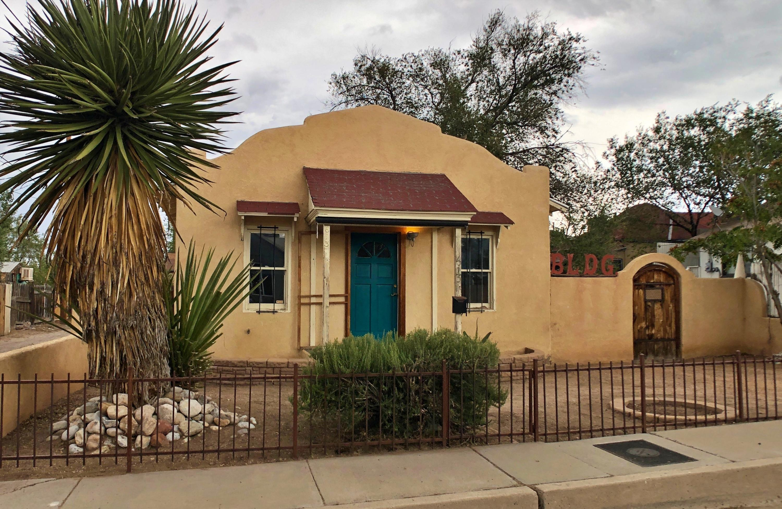 Sweet ''wavy parapet''-style Casita in historic Huning Highlands neighborhood. Built in the 1920s, the spacious loft-like one-bedroom home is over 900sqft, with high-volume arched ceilings, an open floorplan allowing for flexible living space, & a bright playroom/office area with chalkboard-painted wall for all sorts of fun. More to love: wood-topped two-seater kitchen breakfast bar counter & wood ceiling, hardwood floors & some slate in the bathroom, great built-in living room shelving, the bedroom walk-in closet provides plenty of other storage, recessed lighting provides subtle light throughout, & the home has a fresh sleek coat of paint. Outside there's a great south-facing front porch with rolling sunshade & the private high-walled side courtyard is an easy-to-maintain chillspace.