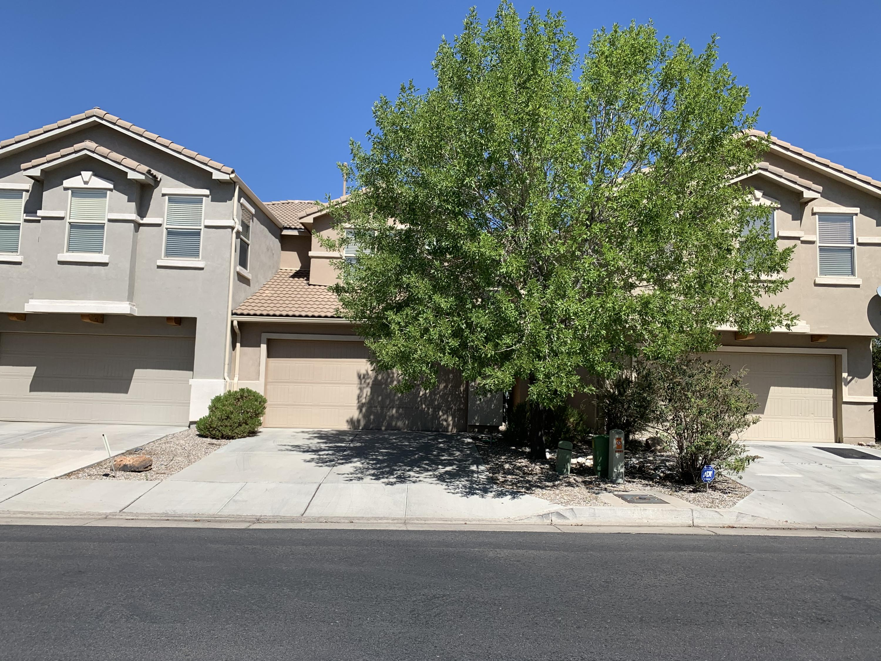 This is a beautiful townhome in a gated community. Open floorplan with lots of natural light. All tile downstairs. Backyard fully landscaped with large patio with little maintenance. Beautiful views of the Sandias. Community clubhouse, gym and community grounds landscaped with walking trails. Owner willing to give $2500 carpet allowance