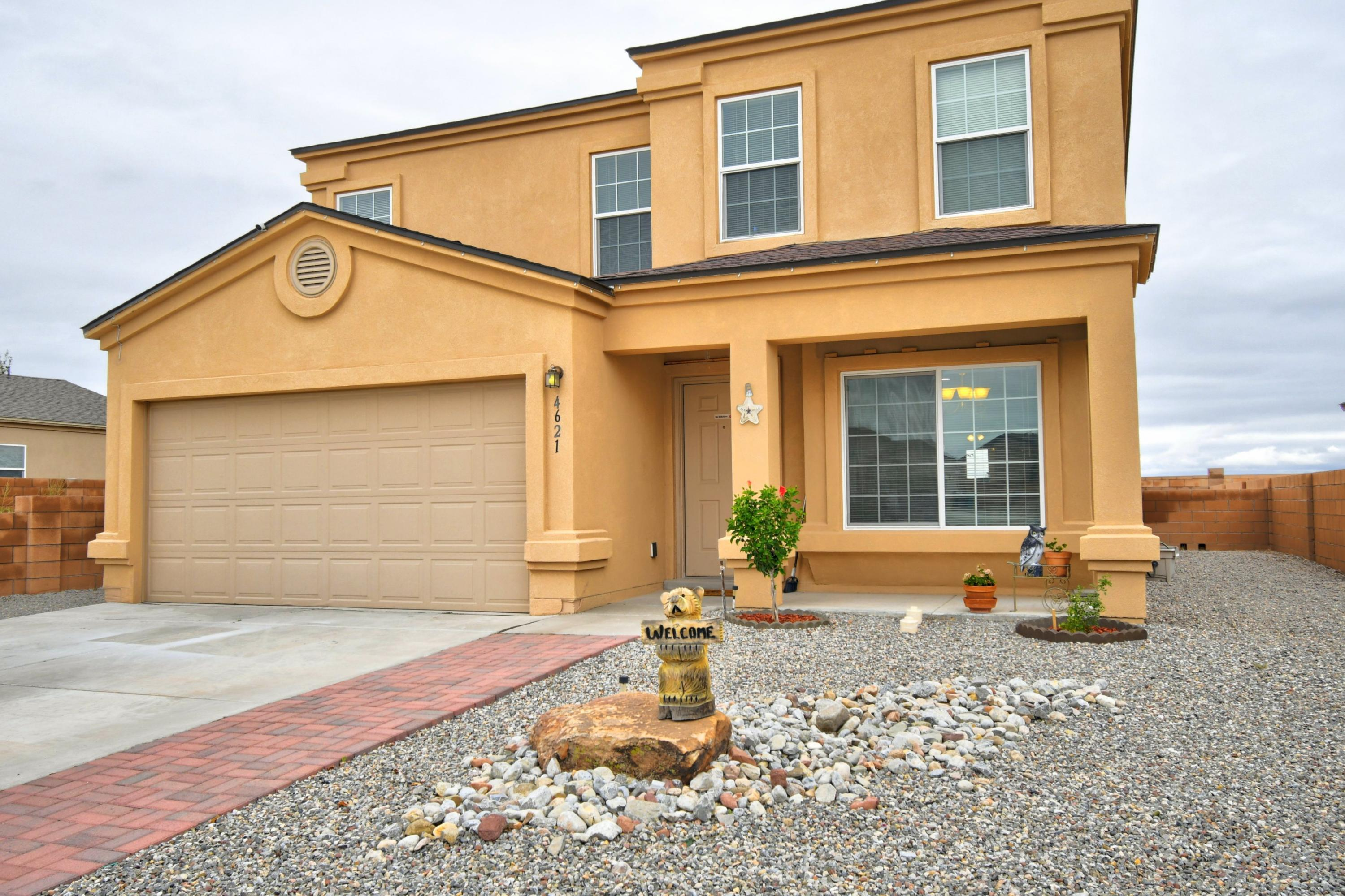 Spacious, move-in ready home, priced to sell! Country living at its best. Versatile floor plan for family living,  entertains well with open concept and includes gas fireplace.  Front alcove window seat provides cheerful atmosphere.  Covered patios front and rear  with upstairs balcony overlooking Jemez Mountain.  Two master suites with additional bedrooms plus loft. No HOA. Must see home!
