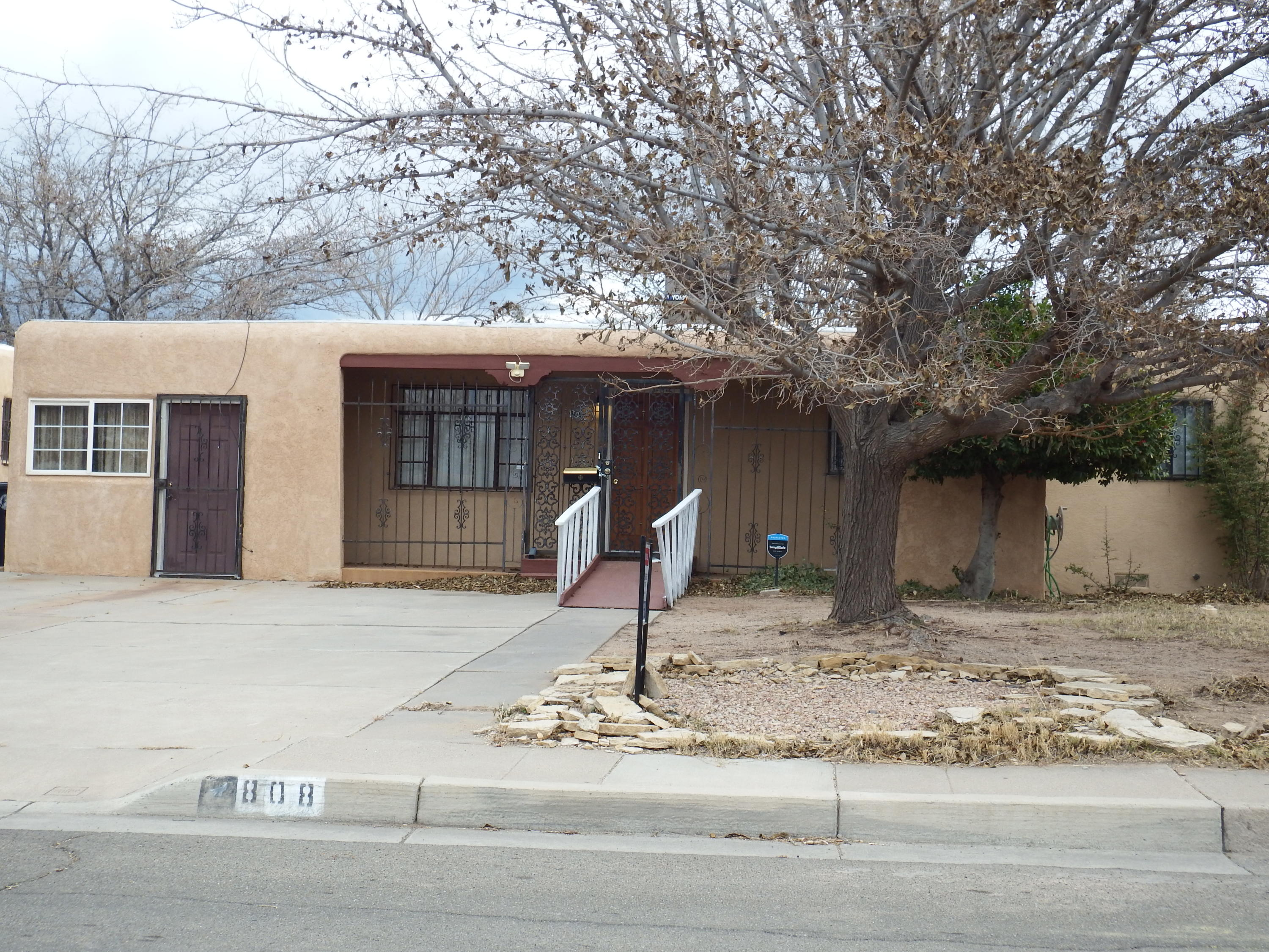 One of a kind,, ready for a disabled Buyer,  3 bedrooms or 4, ADA  compliant shower with its own family room or bedroom., exterior access available, Large gathering room with firepalce,also  a  could be separtate office with own access,  or bedroom with outside accesibility.  Many  possibilites with double attached car garage, access to an alley, completey fenced and security bars attached. Almost new Refrigerated air conditioner unit, newer plumbing from the street to the property,