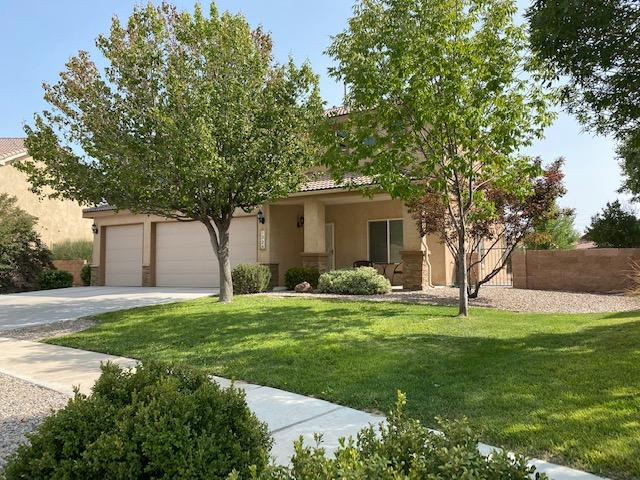Impressive spacious family home in the beautiful Storm Cloud neighborhood. This home features an open floor plan ideal for entertaining featuring a chef's kitchen with endless granite countertops, abundant Cherry wood cabinets, designer tile floors which is open to the spacious family room and cozy fireplace. Downstairs has a guest bedroom and a full bathroom downstairs. The back yard is HUGE featuring a flagstone patio and boasts endless potential! Let the children play outside while you relax. The master bedroom is spacious and features a luxurious master bath, two walk-in closets. The home features three living areas including a loft upstairs. The bedrooms and bathrooms are all very spacious boating ample closet space. All this within walking distance to a beautiful green park!