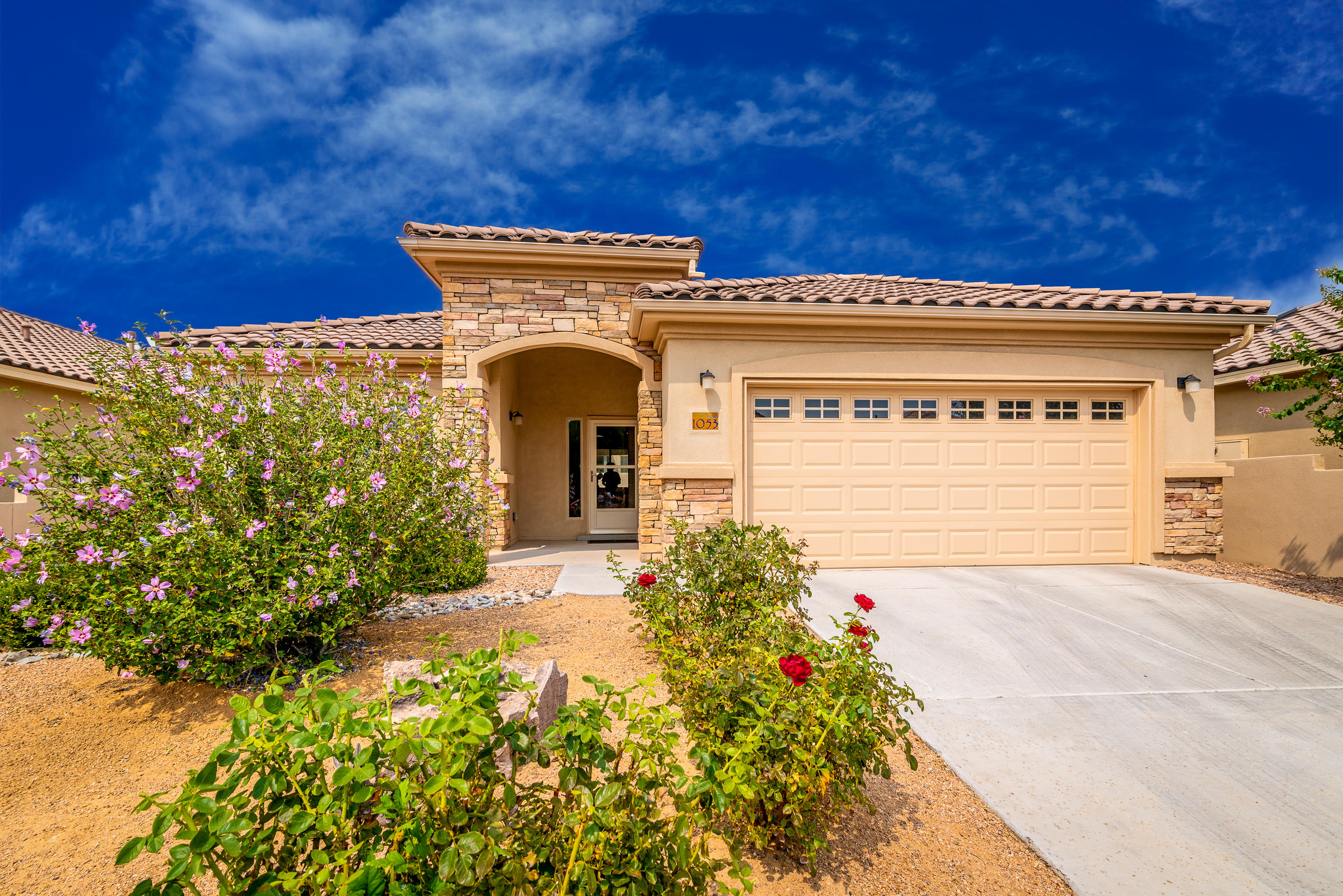 Welcome to Del Webb Alegria, a 55+ Gated Community!  This Popular ''TAOS'' Model is 2156SF and has 3 BR's and 3 Full Baths along with a nice size 2CG, Dining Room, Huge Kitchen w/Island and nook!  Kitchen has an abundant amount of cabinets, granite, gas cooktop, wall oven.  The front patio and nook area have a nice little view of the Sandia's.  The Master Suite includes a large walk in closet, dbl sinks, garden tub and separate shower! All Appliances stay including the washer/dryer & fridge. Soft water system and REF Air! There is a large covered patio and the back wall has been stuccoed to match the home!  Also, there are beautiful custom made iron gates at each side of the home! Enjoy the Clubhouse, indoor/outdoor pools, gym,  daily activities, Bosque trail and so much more!!