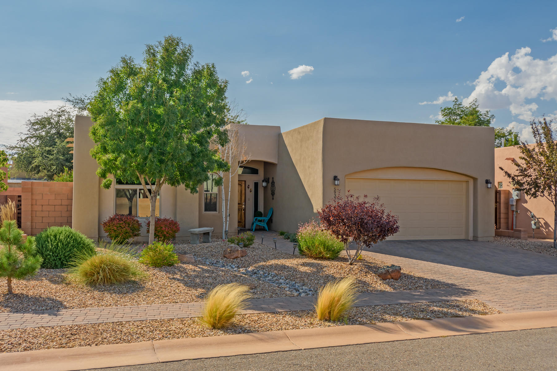 This stunning custom home, in a gated community on Albuquerque's westside will blow you away! Main living is great room concept with raised ceiling and gas fireplace with stone accents. The bedrooms are all separated. Wood floors and tile throughout main areas with knotty alder cabinets, granite, snack bar island and SS appliances. Master bath has door-less walk-in shower, whirlpool tub and access to the laundry room from master closet. Tons of storage with pantry, linen closets and shelving maximization in all closets. There is a water softener, custom blinds, built in speakers, professionally landscaped backyard with large patio, wired for TV on the covered patio. Insulation package includes R-49 in ceiling with blown-in fiberglass exterior 2x6 walls, finished garage